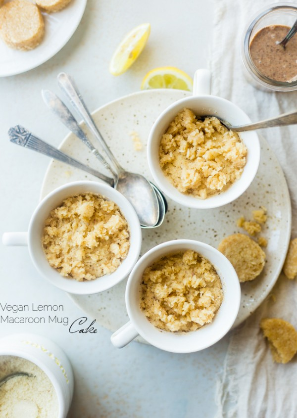 Gluten Free Lemon Macaroon Vegan Mug Cake - Have cookies IN your cake with this easy, gluten free vegan mug cake that's mixed with crumbled up lemon macaroons. It's a healthy dessert that's ready in under 5 minutes!   Foodfaithfitness.com   @FoodFaithFit