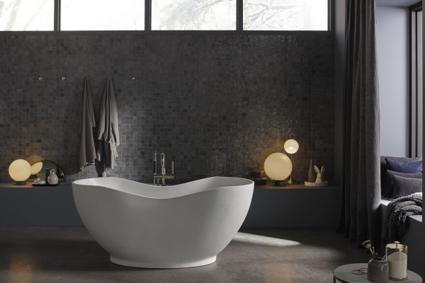 Abrazo freestanding bath    Purist bath filler      Boasting a deep oval shape inspired by clay pottery, this freestanding bath allows you to fully immerse yourself in the art of relaxation.