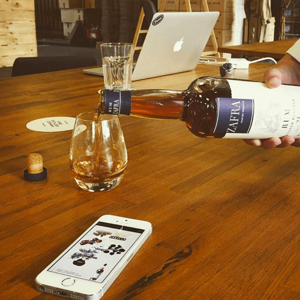 Zafra Rum Being Poured in Flaviar Office
