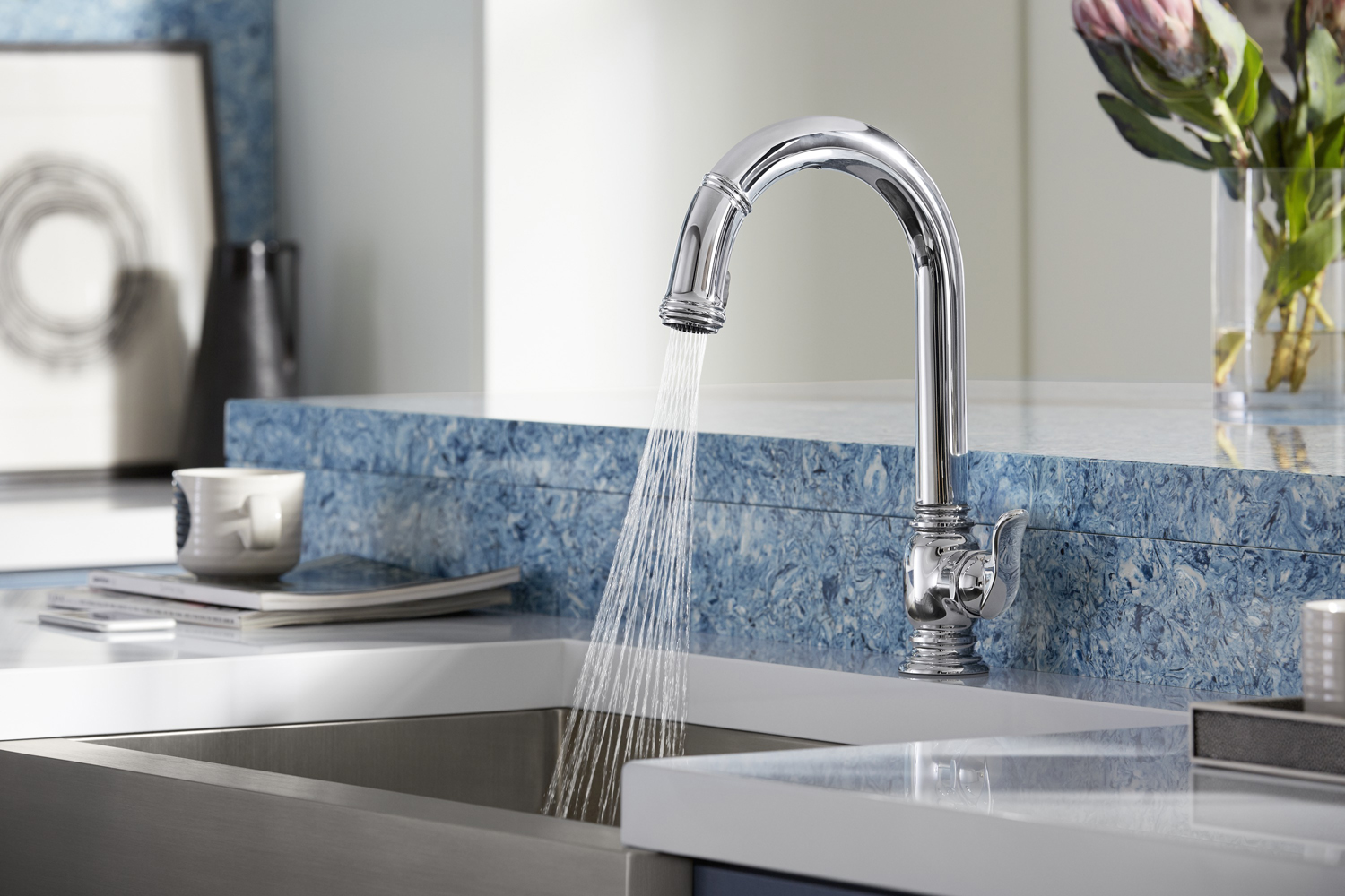 Strive® farmhouse kitchen sink     Beckon® touchless kitchen faucet     White Zeus Extreme countertop     Albedo wall and breakfast counter     Make food prep and cleanup easier and cleaner with a touchless faucet. Simply wave your hands under the faucet to turn it on.