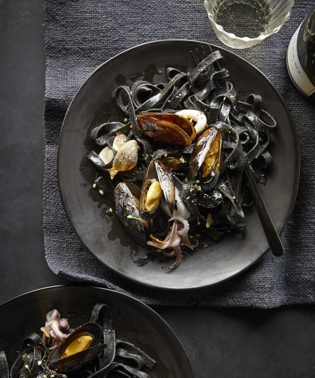 A study in black: Squid-ink linguine with  fruiti di mare .  Get the recipe.