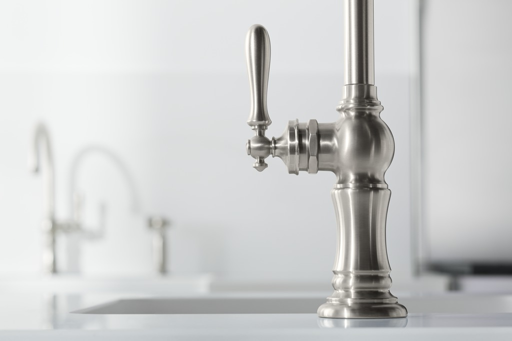 Artifacts faucet   The faucet's vintage-style details make it perfect for a converted-warehouse kitchen.