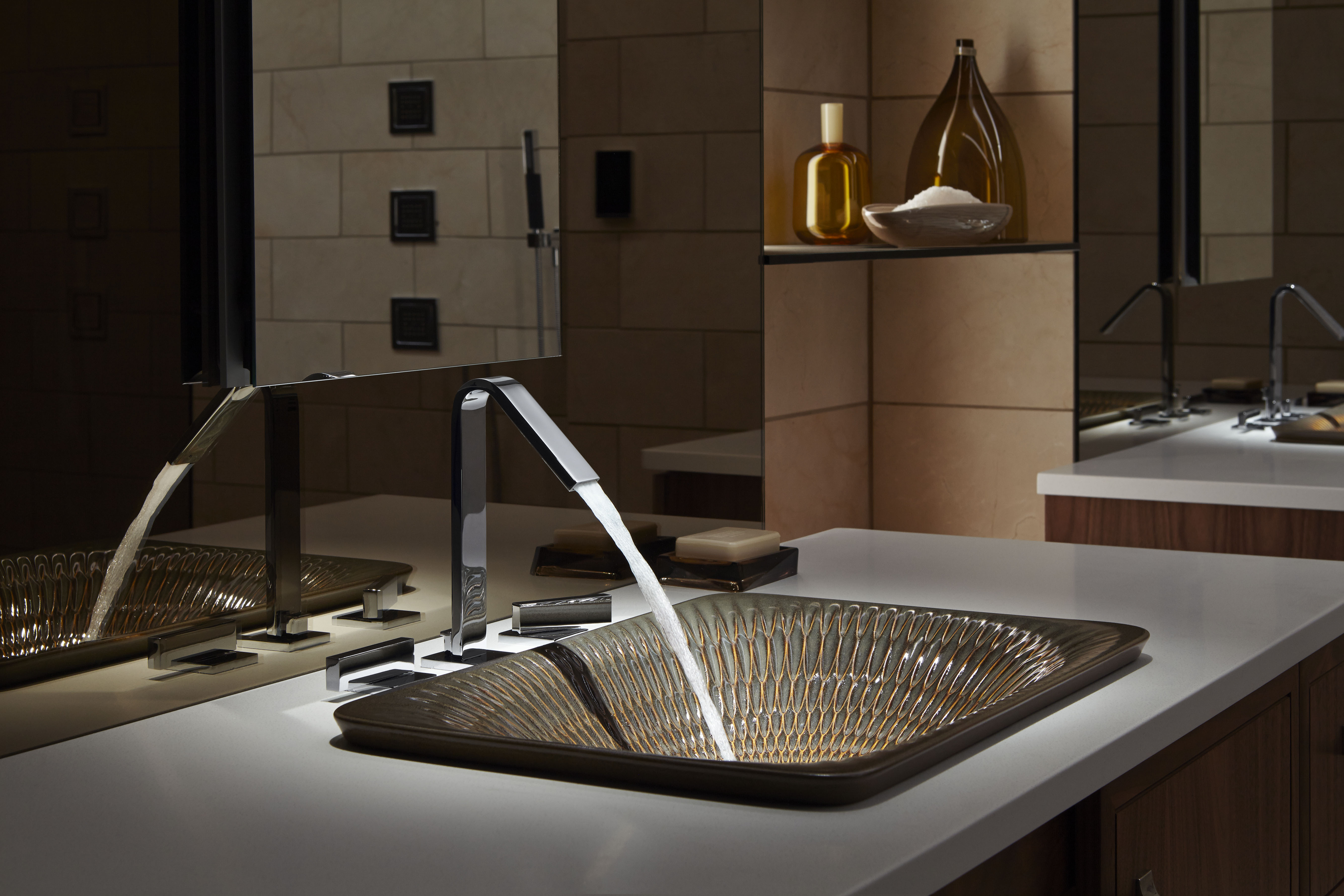 Loure Faucet     Derring Sink     Create visual tension by blending an artistic textured sink with a clean Polished Chrome faucet finish.