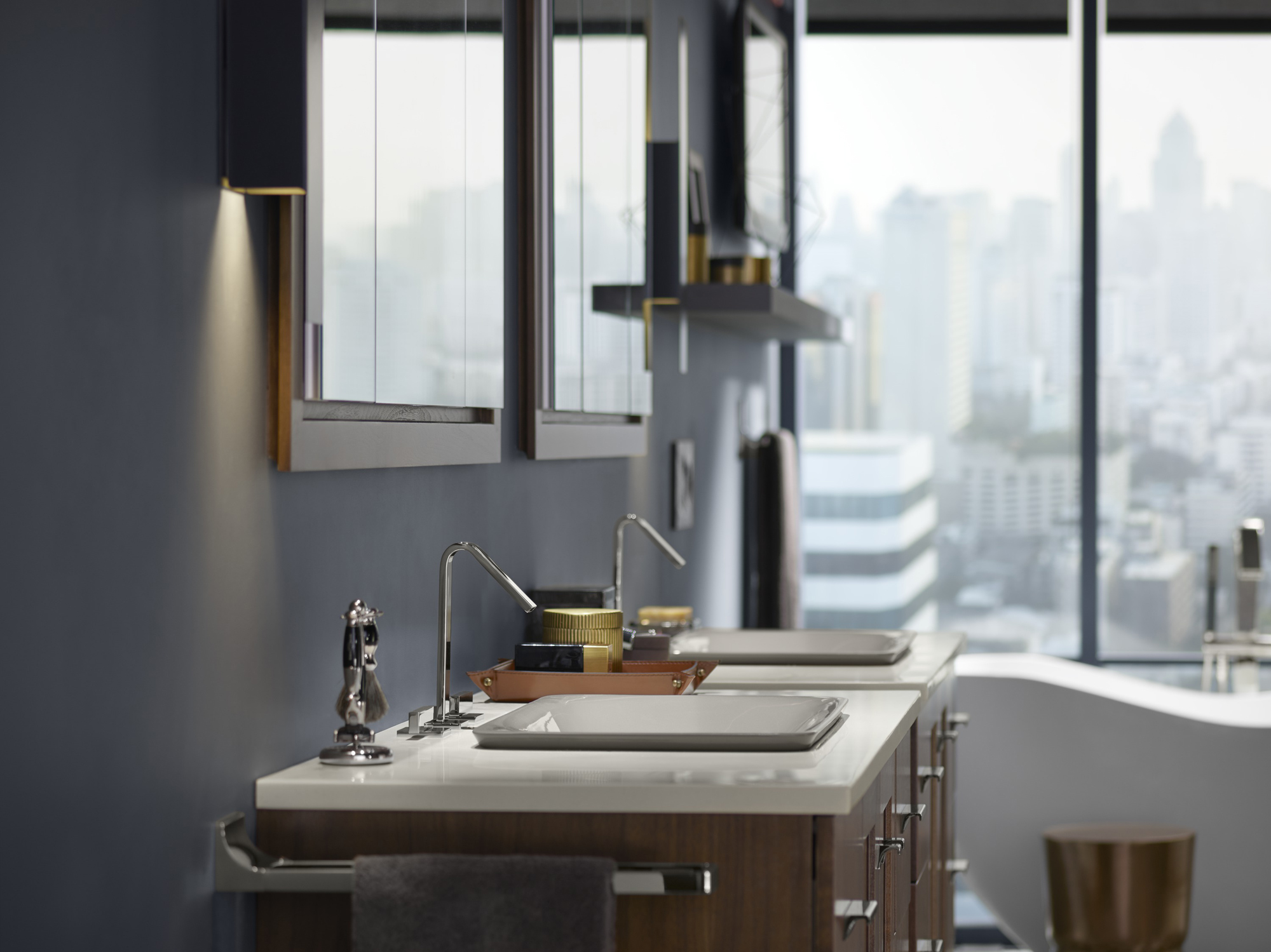 Solid/Expressions® vanity top    Loure® faucet     Ultra-sleek faucets and low-profile Carillon® Wading Pool® sinks keep the vanity area looking modern and clutter-free.