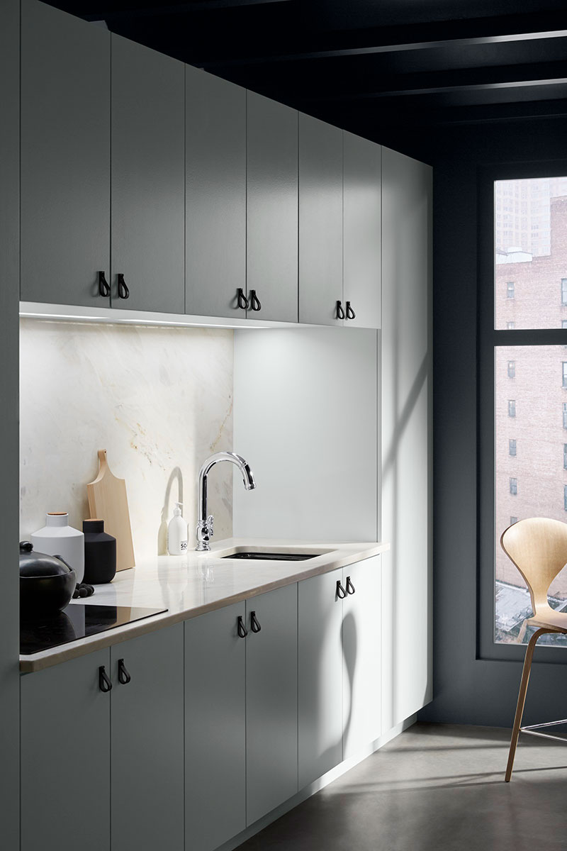 Beckon Faucet   Iron/Tones Bar Sink    Calming whites shed light on a streamlined prep space with an elegant prep faucet designed with touchless technology.
