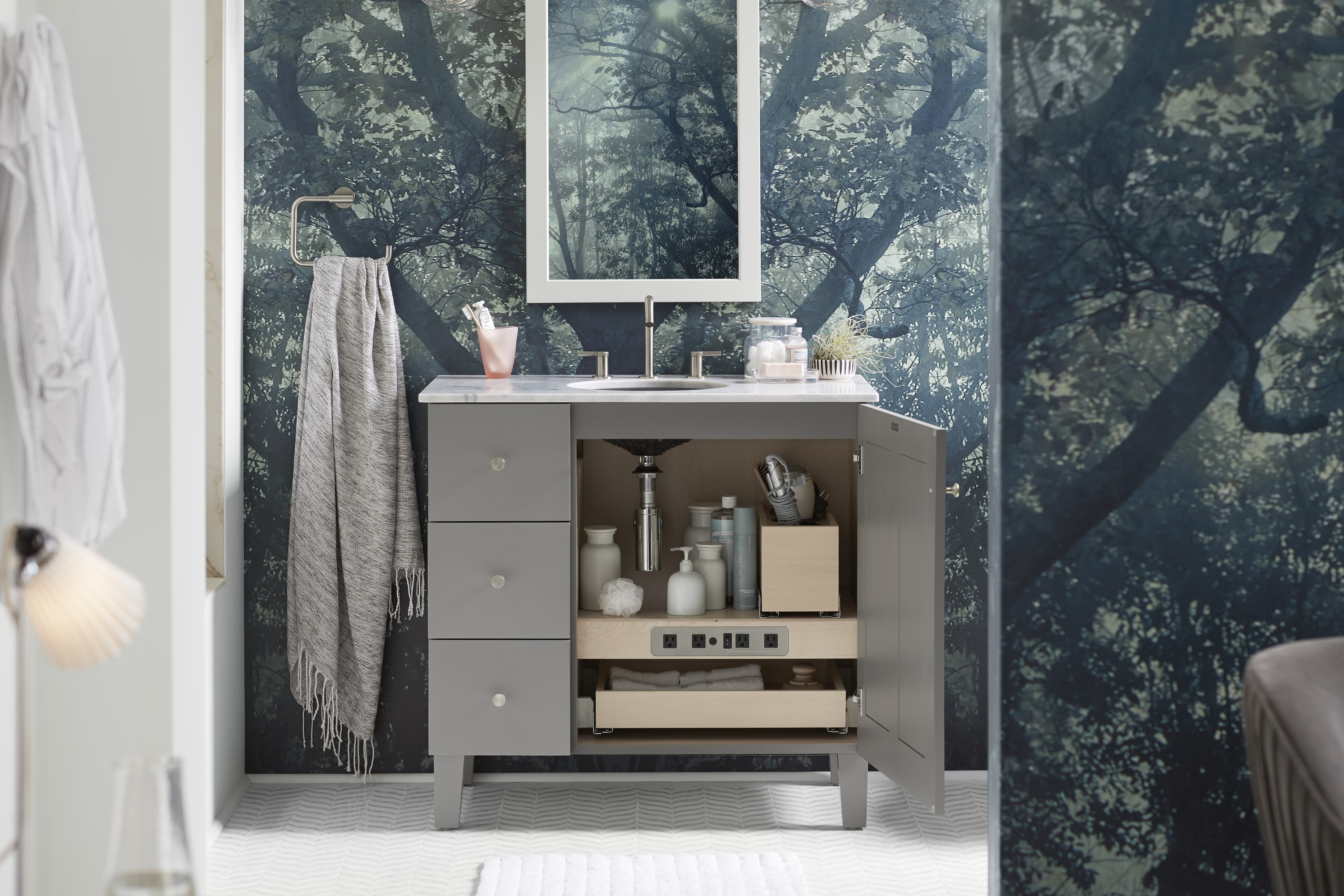 Poplin® vanity     Adjustable shelf with electrical outlets     Rollout tray     Purist® cabinet knob     The rollout tray and built-in electrical outlets turn the room's single vanity into a storage powerhouse.