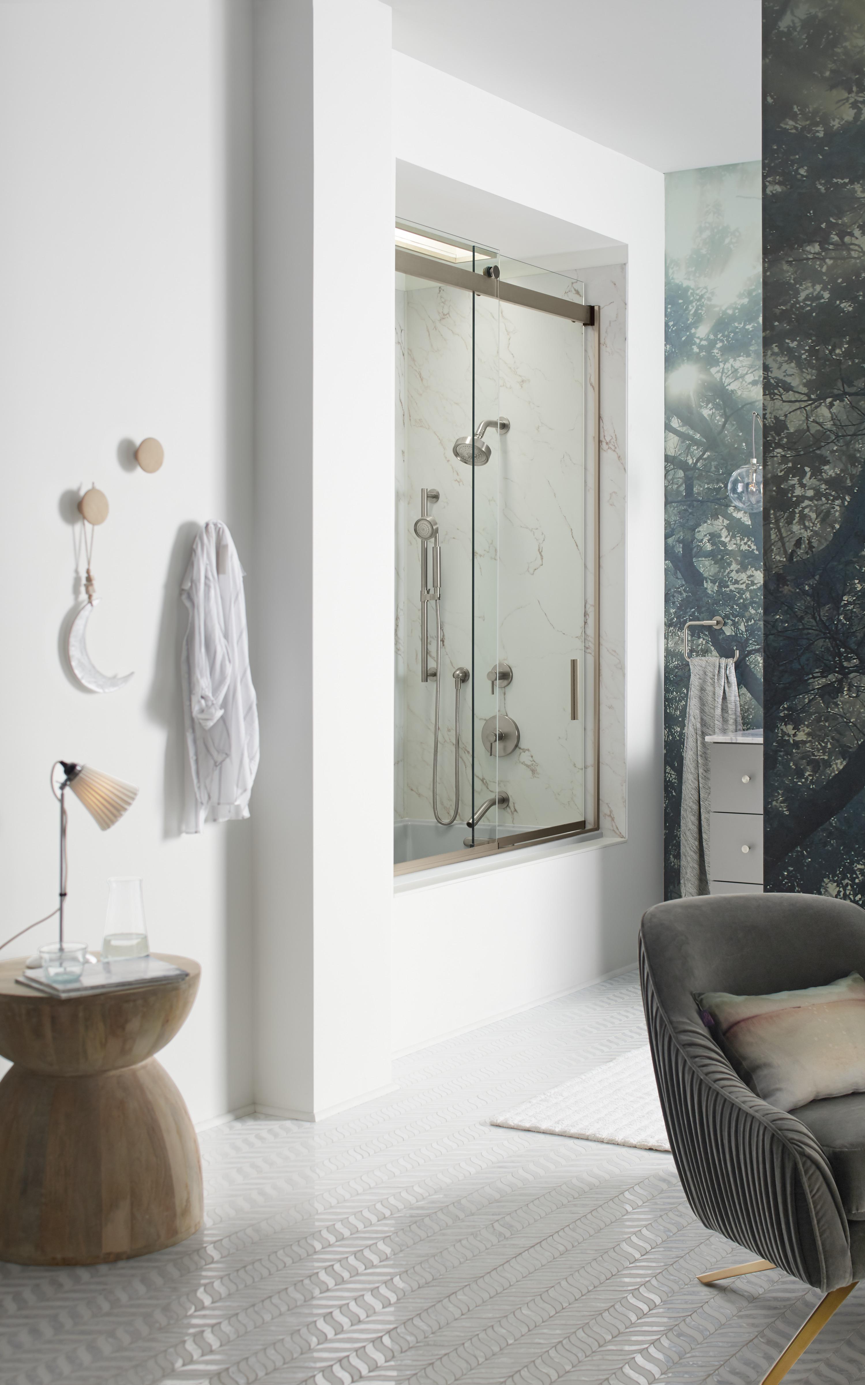 Levity® shower door     Choreograph® shower walls     Purist® handshower     Purist Showerhead     Stillness® valve trim     A glass shower door, rather than a shower curtain, makes a small space feel more open.