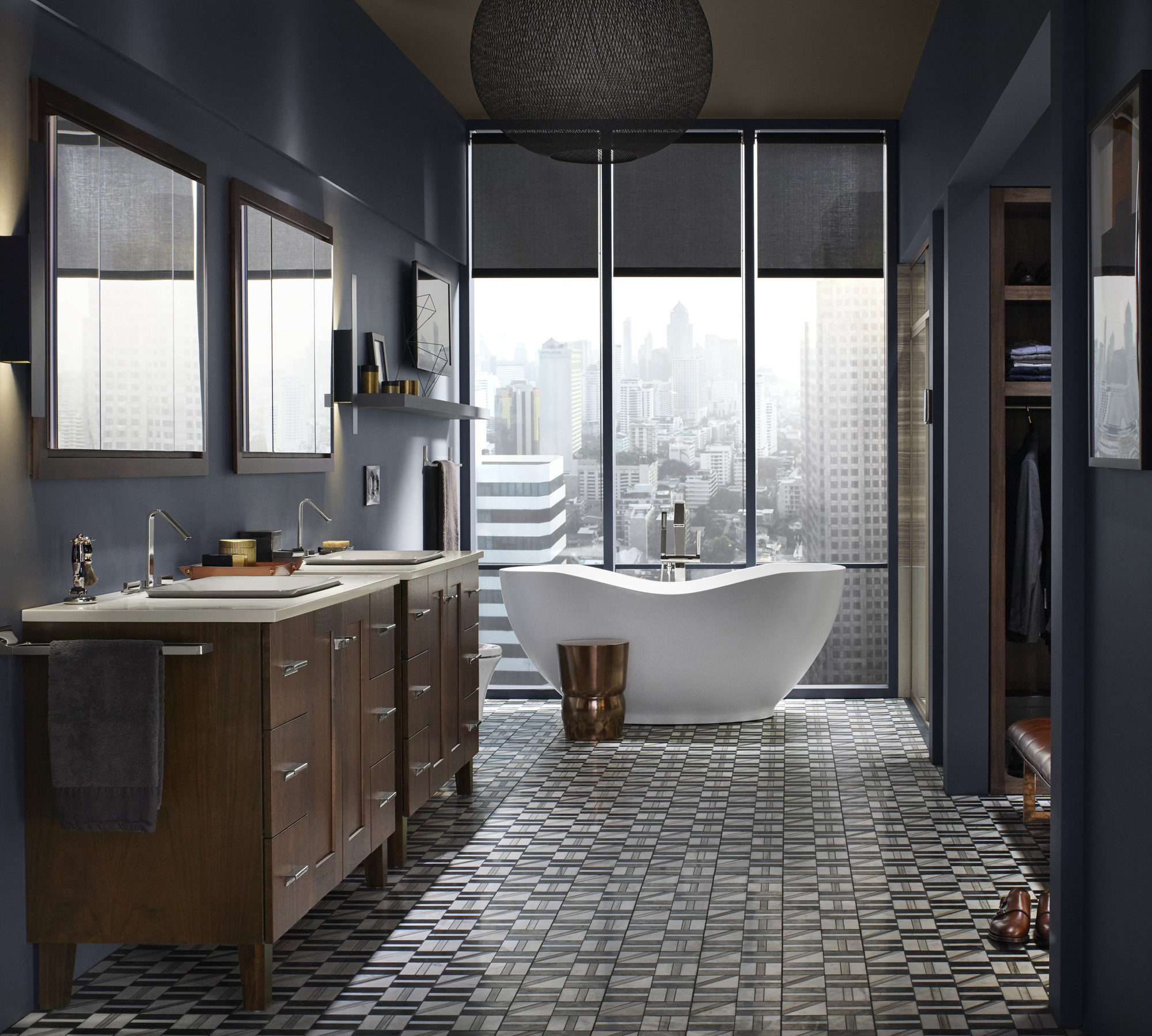 Poplin® vanity    Carillon® Wading Pool® sink    Abrazo® bath    ANN SACKS® Liaison tile     Perfectly placed by the window, this organic, oval-shaped bath draws the eyes toward captivating views of the city.