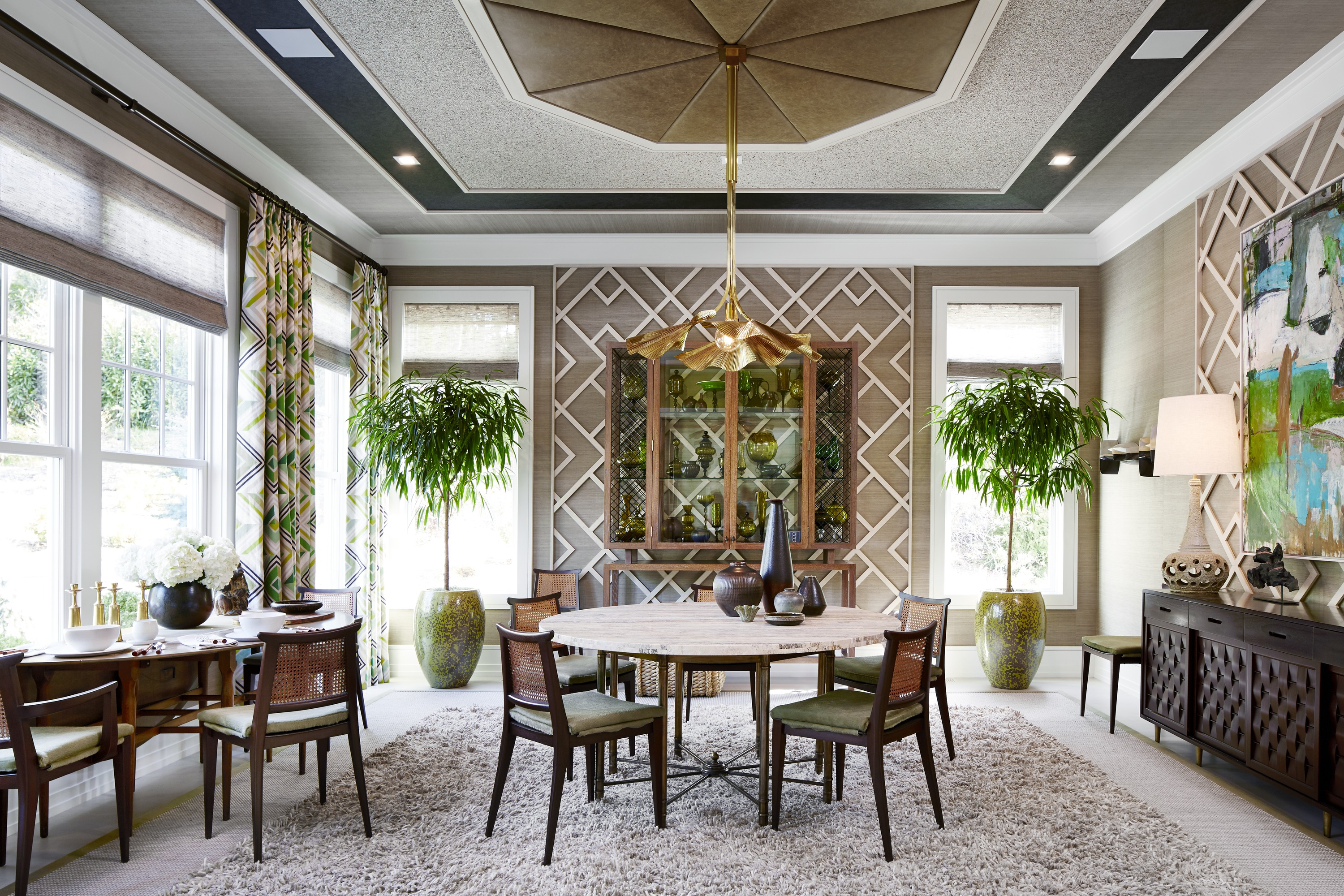 The formal dining room takes a contemporary approach to classic elements, honoring traditional materials like leather and caning, but applying them in fresh ways.