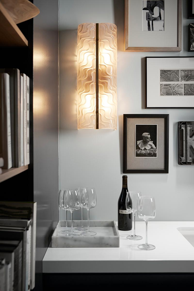 Handcrafted wall sconces illuminate the bar nook, creating interest, creativity and vintage appeal.