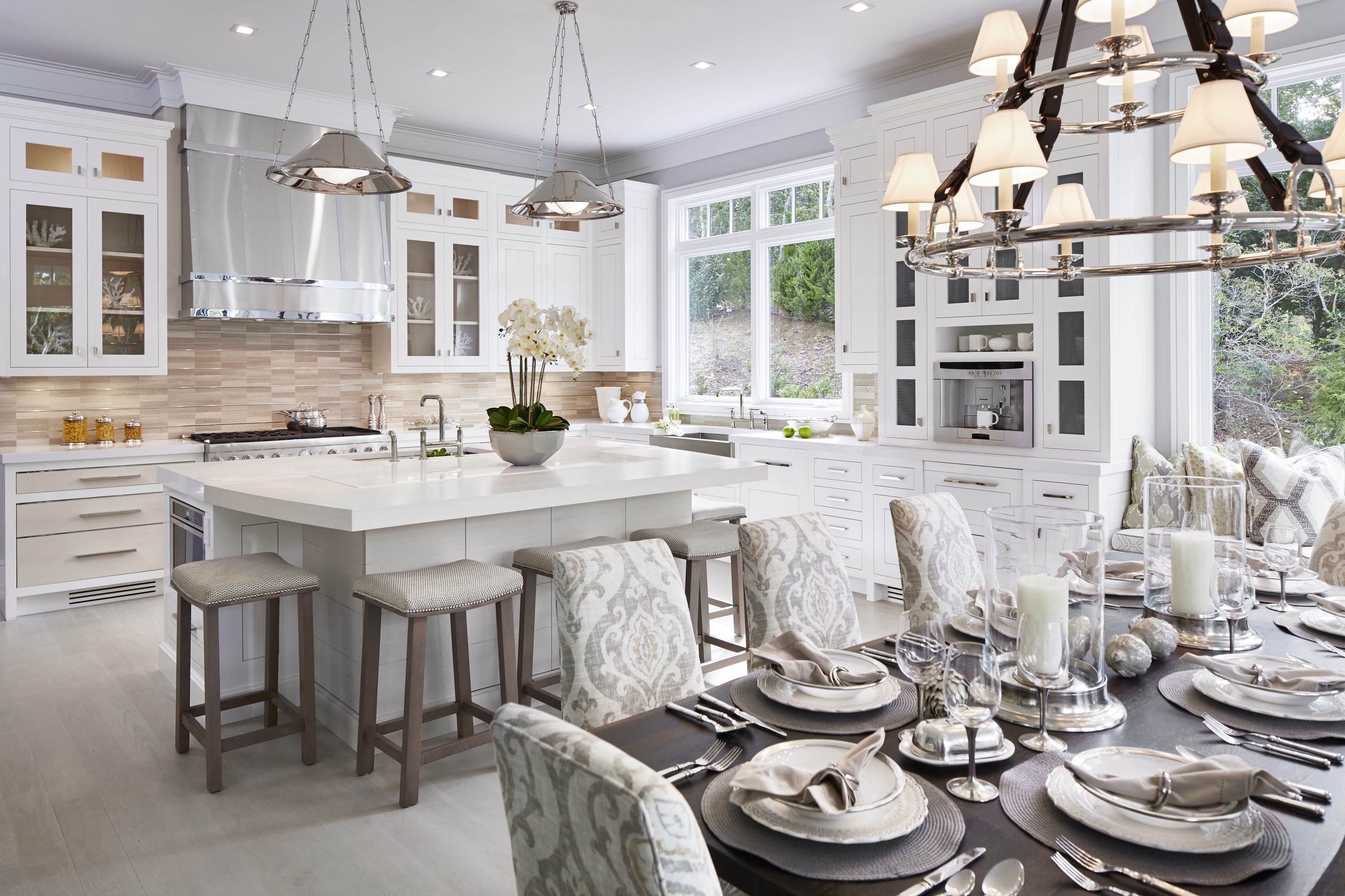 Purist Bridge Kitchen Faucet     Prolific Kitchen Sink     Vault Apron-Front Sink     The vision of custom cabinet designers Bakes & Kropp, this kitchen's thoughtful layout includes ample built-ins to house everything from delicate stemware to an espresso bar.