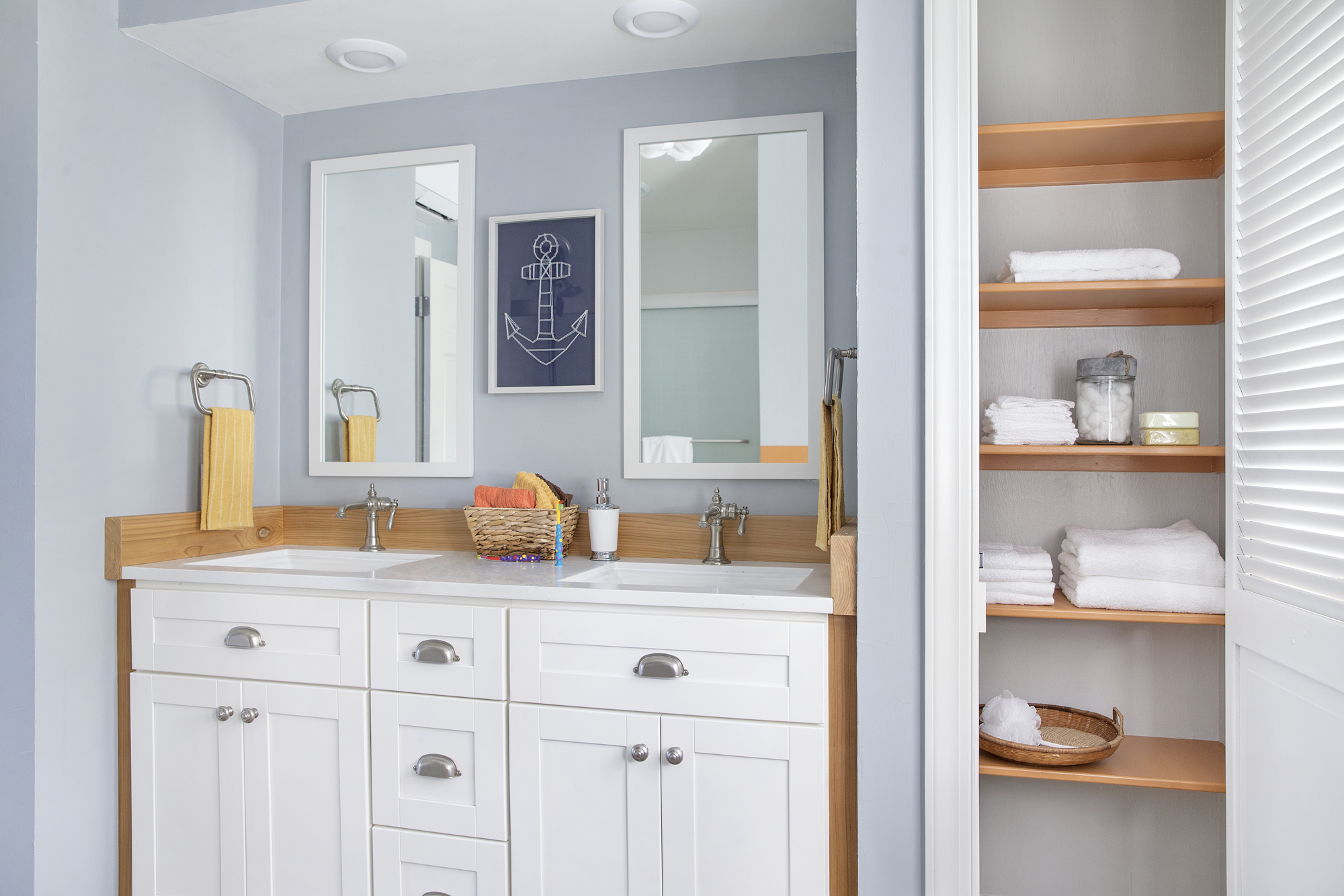 Jacquard® mirror     Memoirs® sink    Artifacts® faucet    Solid/Expressions® vanity top    Artifacts towel ring      A dual-sink vanity with ample storage is ideal for siblings getting ready for school together. Faucets and cabinet knobs in brushed nickel along with vintage details add subtle charm.