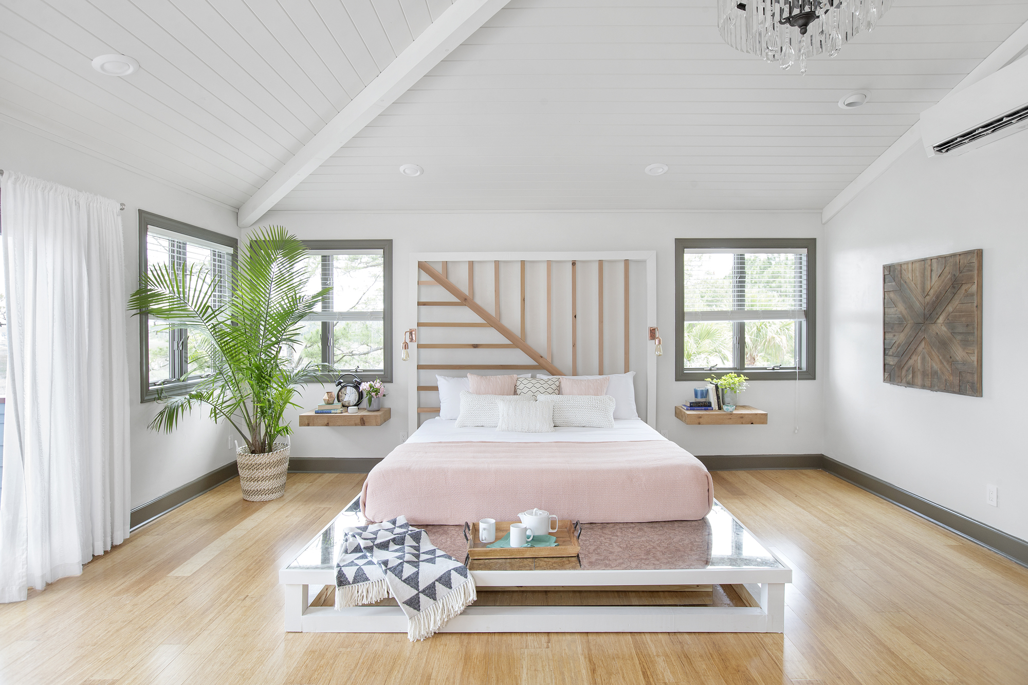 Serenity defines the mood of the master bedroom: A minimalist, clutter-free approach is softened with pale pinks, natural woods and a gabled ceiling.