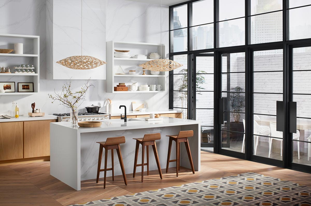 Purist Faucet     Silestone Eternal Calacatta Gold Backwall     Silestone Iconic White Countertop      An outdoor dining area maximizes apartment space in the city – and it works when you have a kitchen bar inside that duals as an eating area.