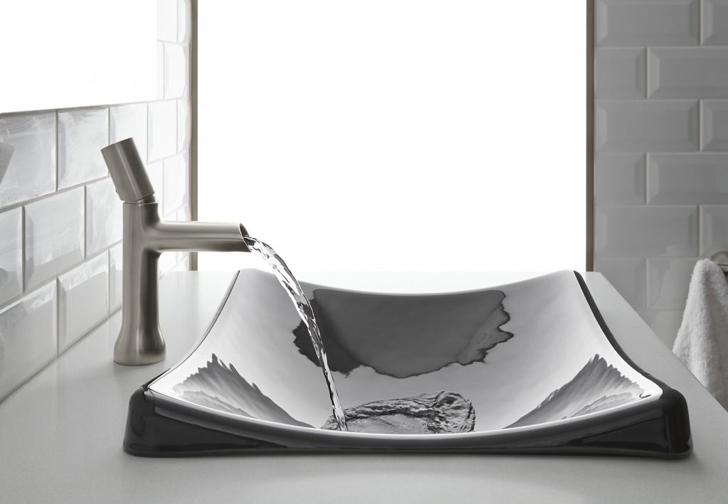 Toobi faucet   DemiLav sink   Light and water play pleasingly on a shallow basin's soft curves.
