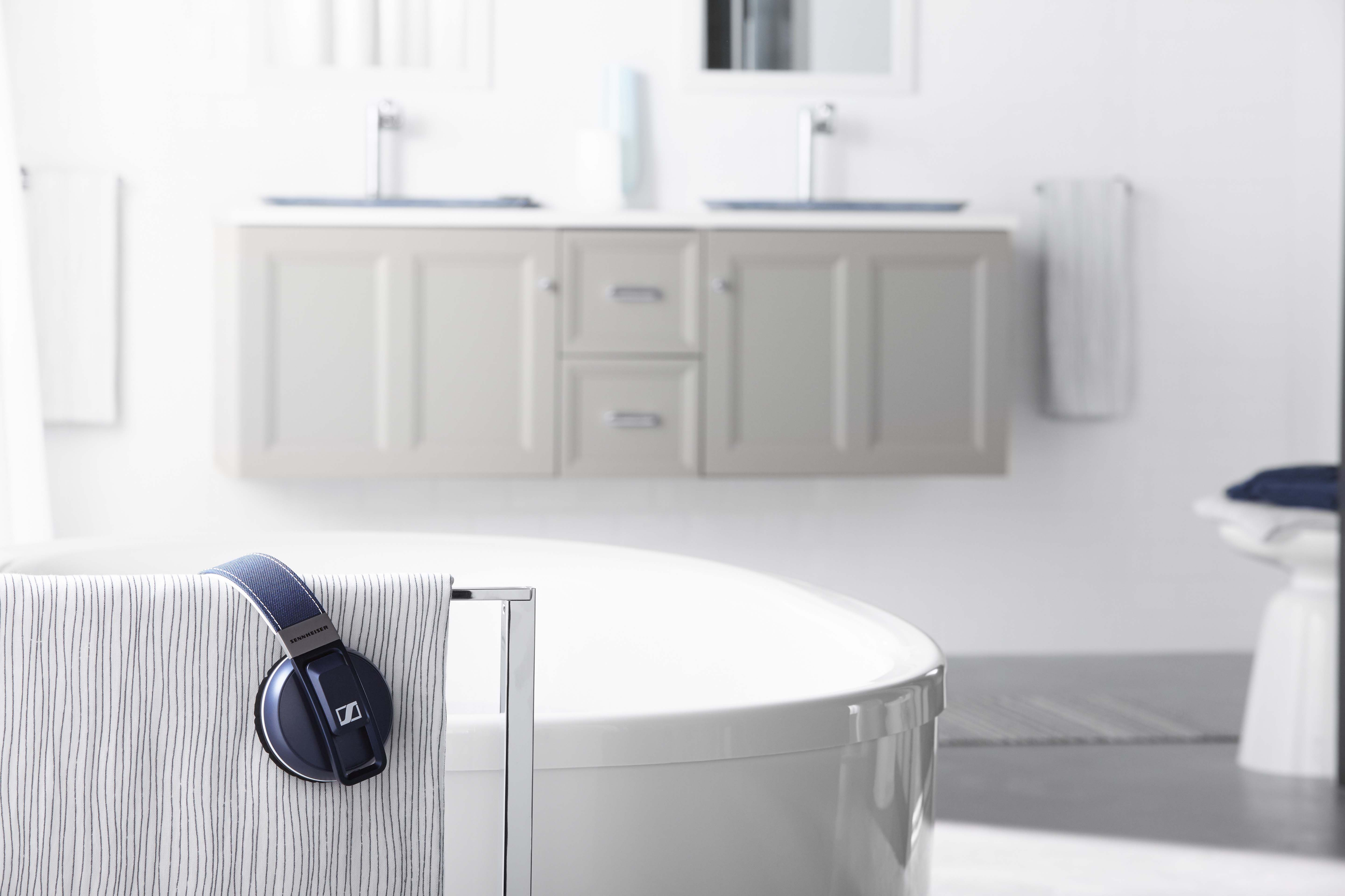 Sunstruck Freestanding BubbleMassage™ Air Bath     Damask Vanity     Composed Tall Sink Faucet     Inia Bathroom Sink     Warm natural light, soft grays and a deep soaking bath make this an ideal spot to escape to. All you need is the right music.