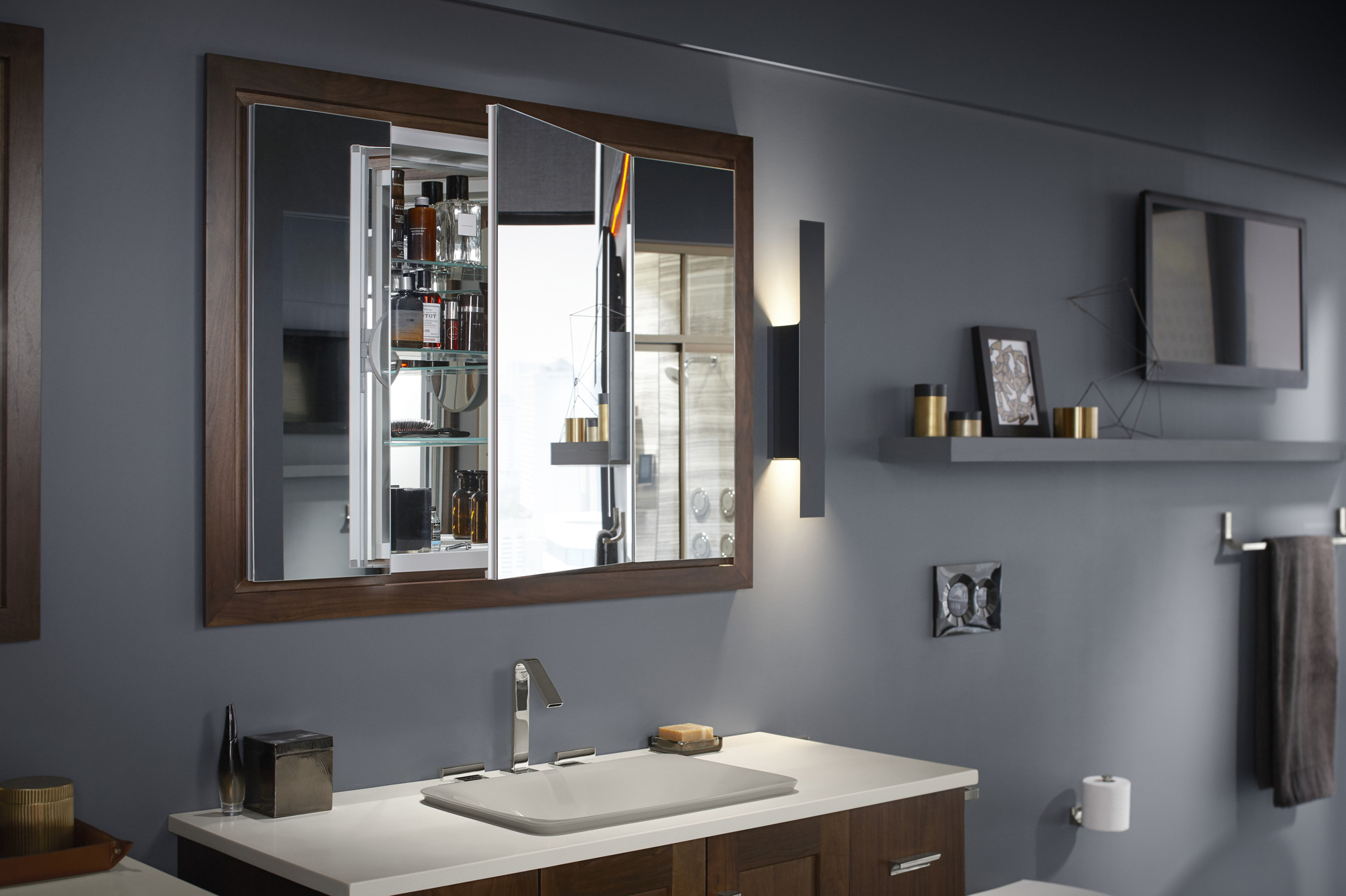 Loure® faucet   Carillon® Wading Pool® sink   Verdera® medicine cabinet   Poplin® medicine cabinet surround     Interior mirrors and an adjustable-height magnifying mirror are great for shaving or applying makeup.