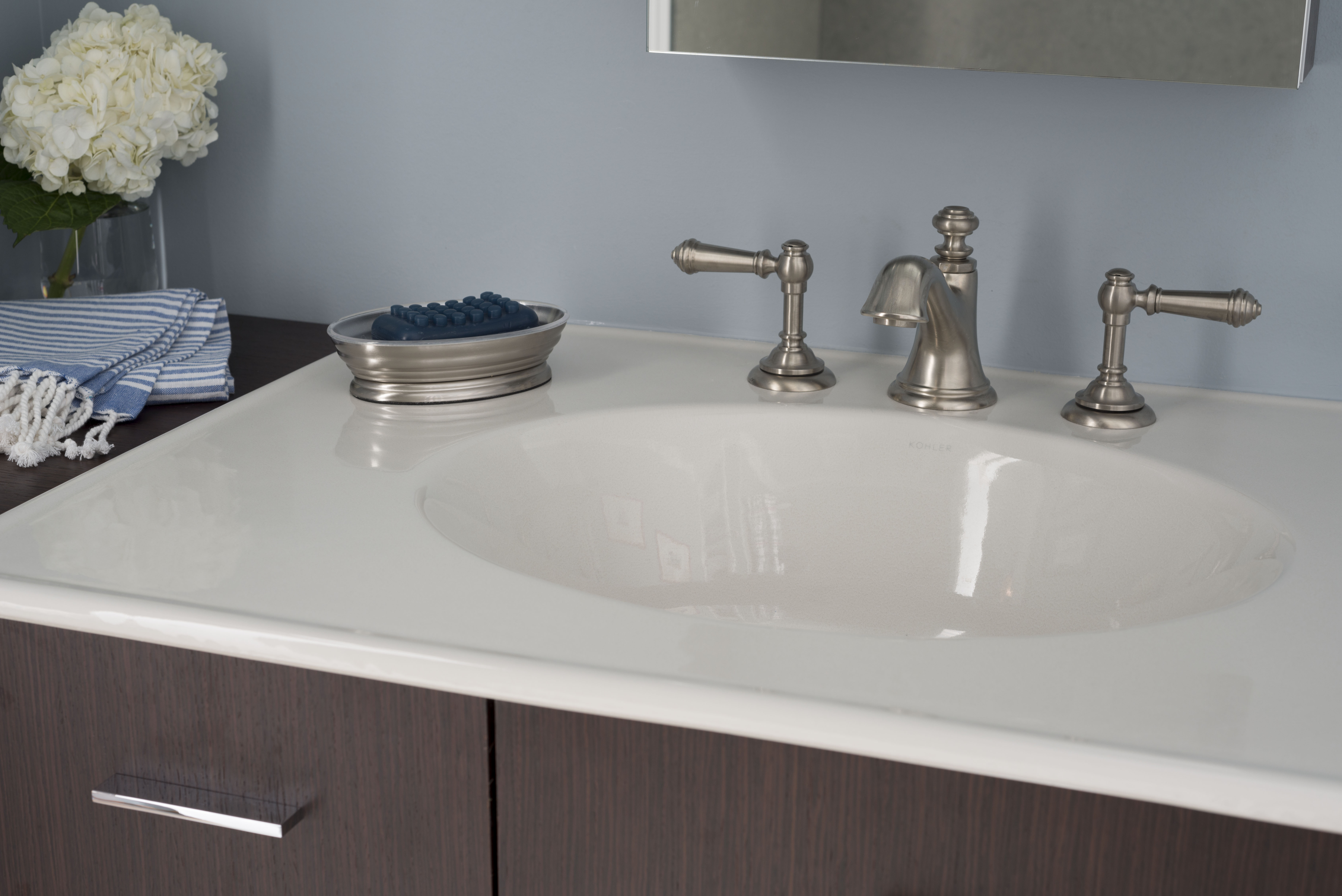 Artifacts Faucet Spout     Artifacts Faucet Handles     Ceramic/Impressions Vanity Top     If you are in a starter home you can create a simple yet charming look by pairing a Brushed Nickel finish with pastel colors.