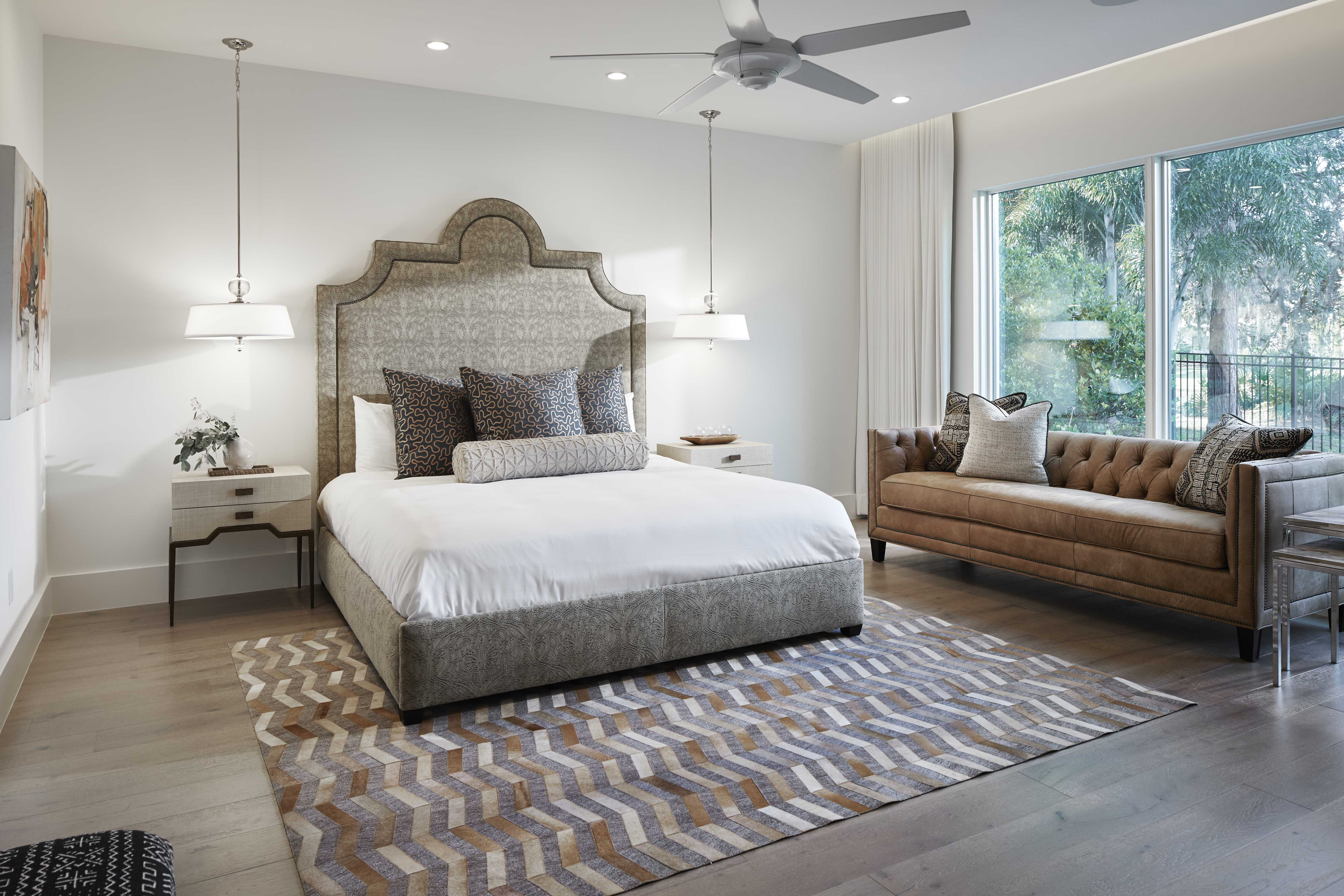 The master bedroom pumps up the warmth quotient with a wood-floor foundation, browns that lean toward the golden end of the spectrum and soft, creamy whites.