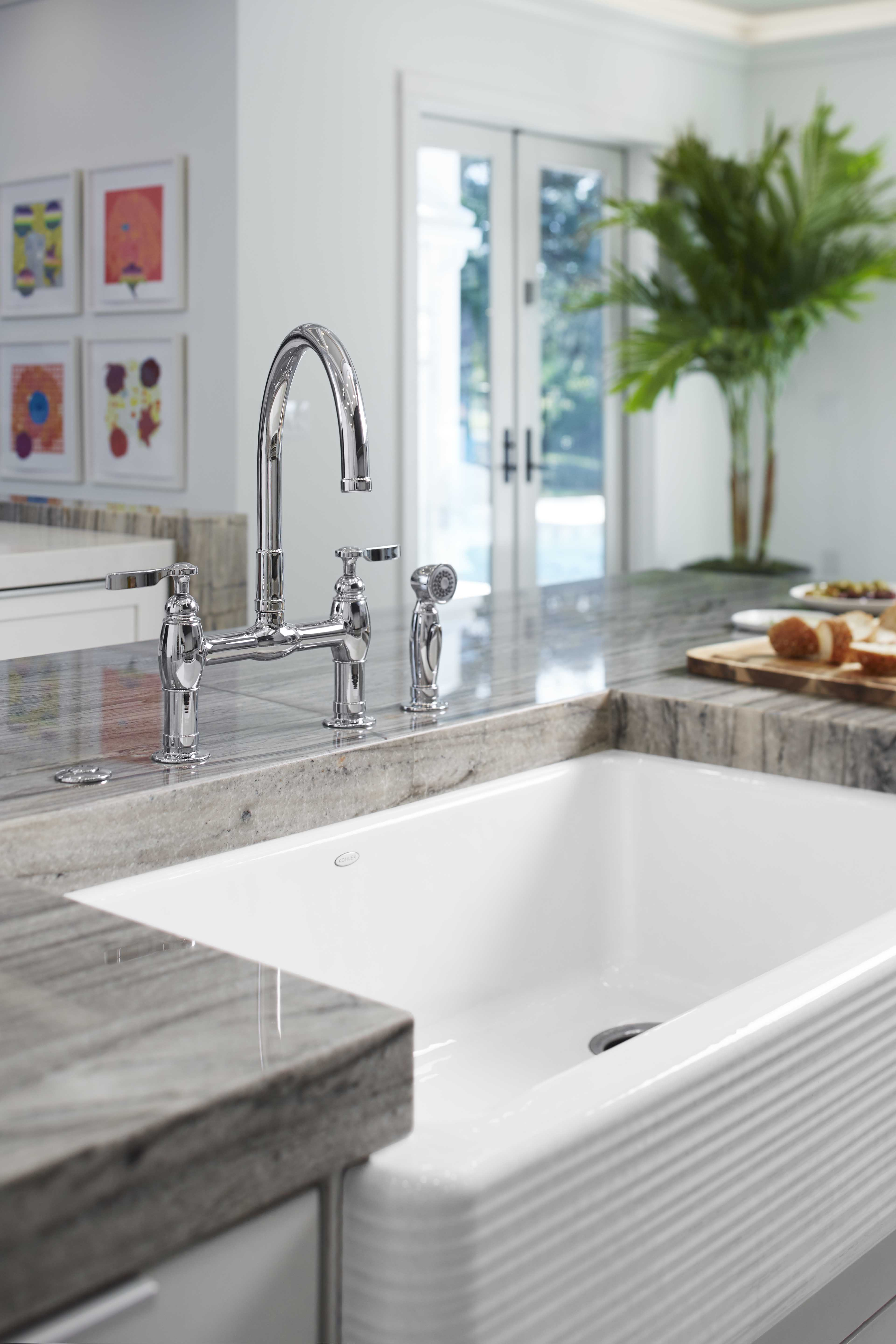 Parq Kitchen Faucet     Hayridge Design on Whitehaven Kitchen Sink     Set into granite, a cast-iron sink delivers the clean look and functionality of a large single basin while the apron-front design introduces artistry and classic farmhouse style.