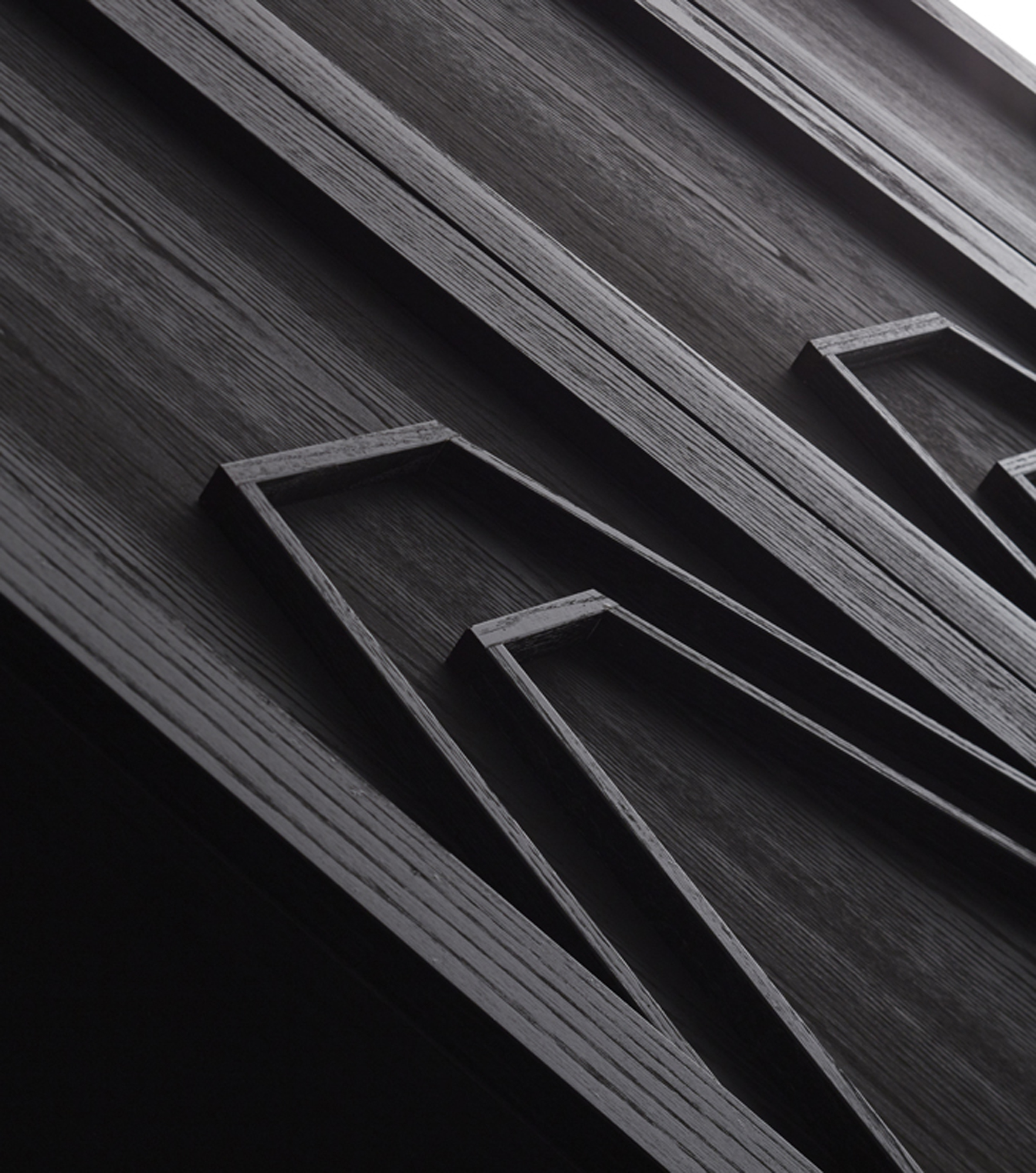 Tailored to perfection, the ebony cabinets feature simple geometric patterns adding another layer of visual interest.