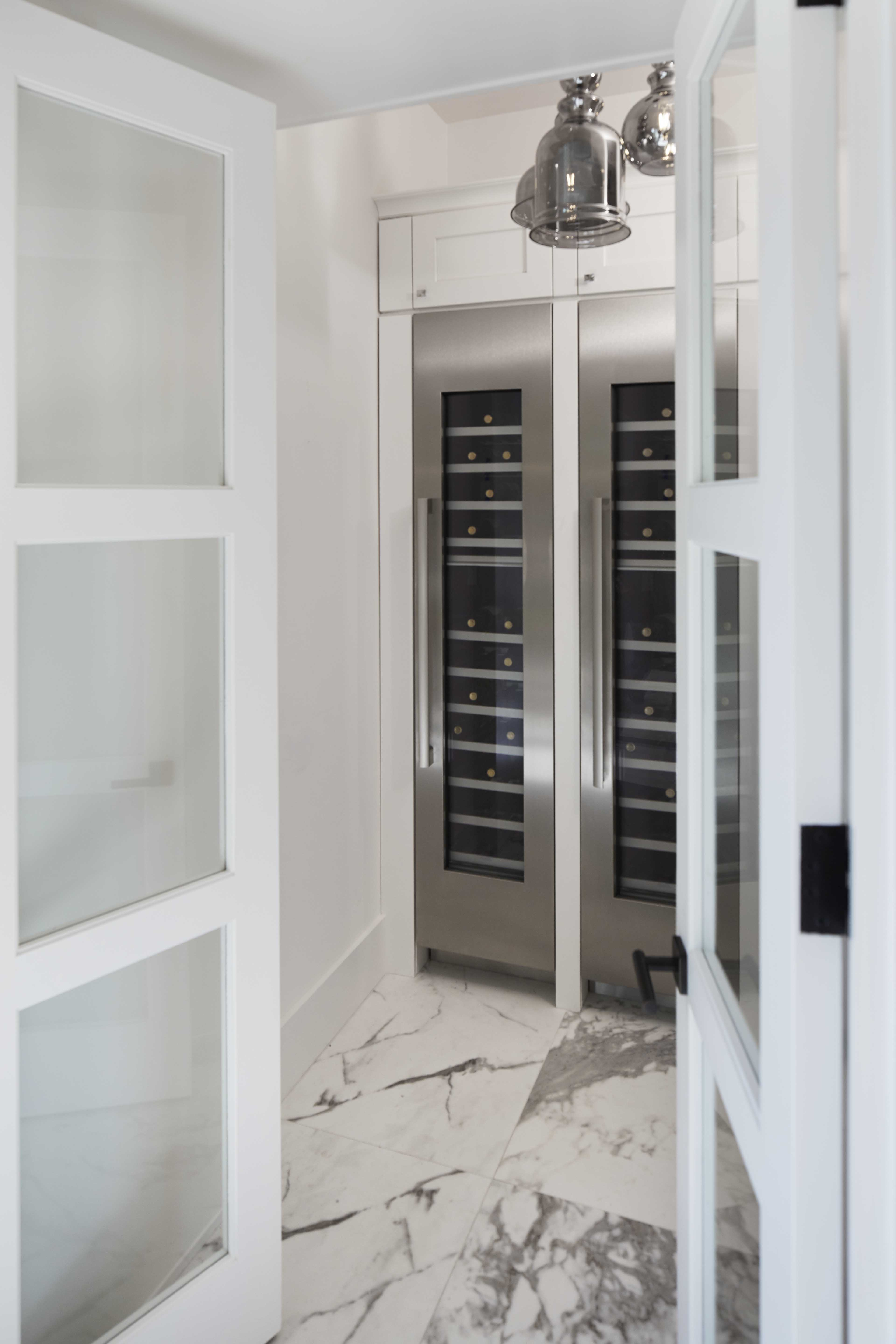 A walk-in wine cellar off the kitchen ensures drop-in guests are always welcome.