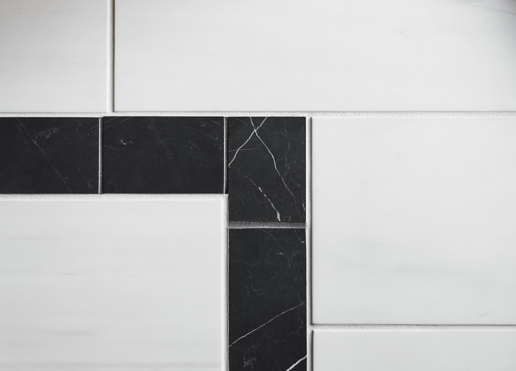 Nero Marquina     Dolomite Corina     A border of Nero Marquina marble set within Dolomite tile is just one more nod to traditional architecture.