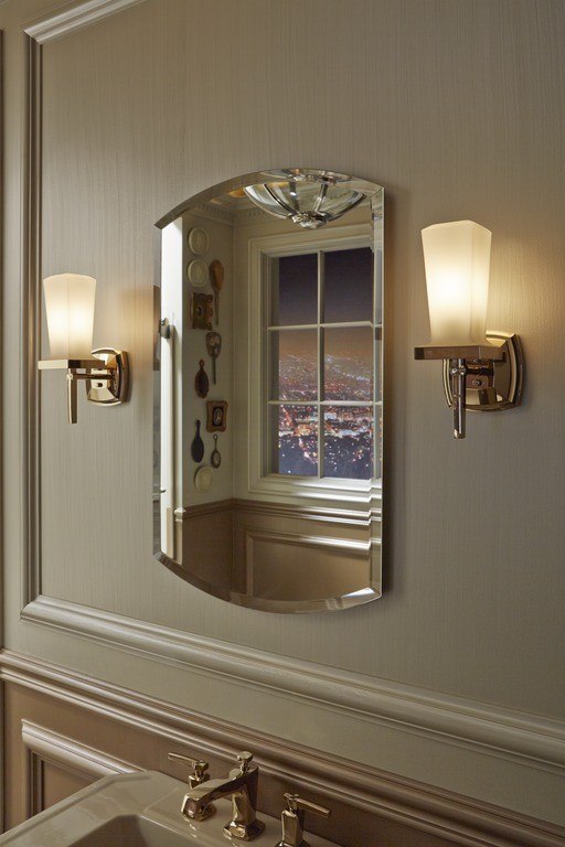 Margaux wall sconce   Margaux faucet   Sconces flanking the mirror add a warm glow that helps light your way to a perfect reflection.