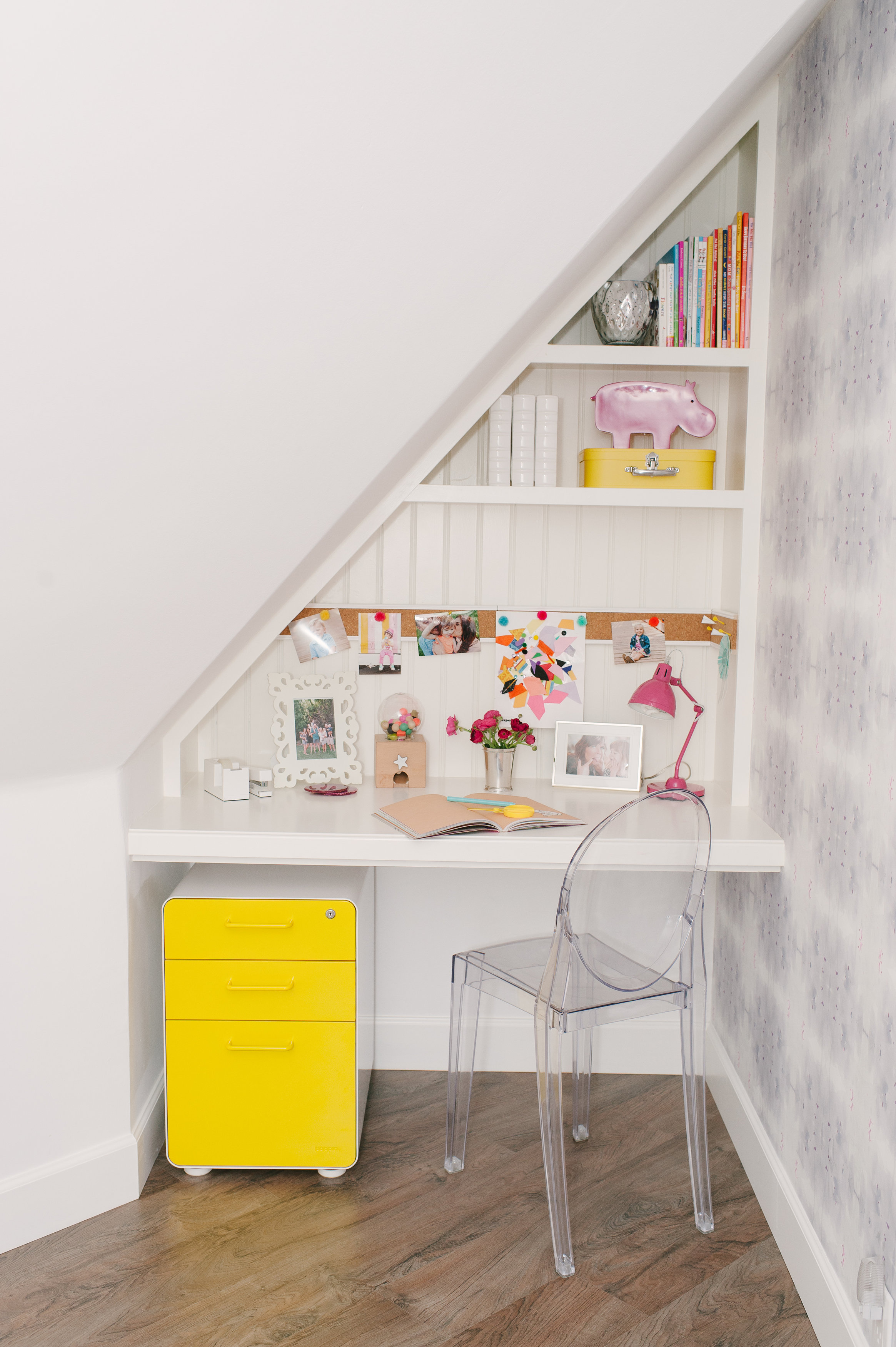 Lewis worked with the home's quirky angles to create a study nook for Harper with a sunny-yellow file cabinet on wheels.