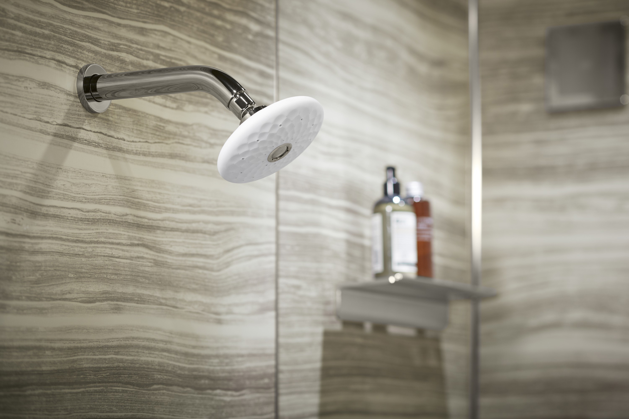 Choreograph® shower walls   Exhale® showerhead     This multi-function showerhead lets you choose from four experiences: full coverage, drenching rain, pulsating massage, and silk.