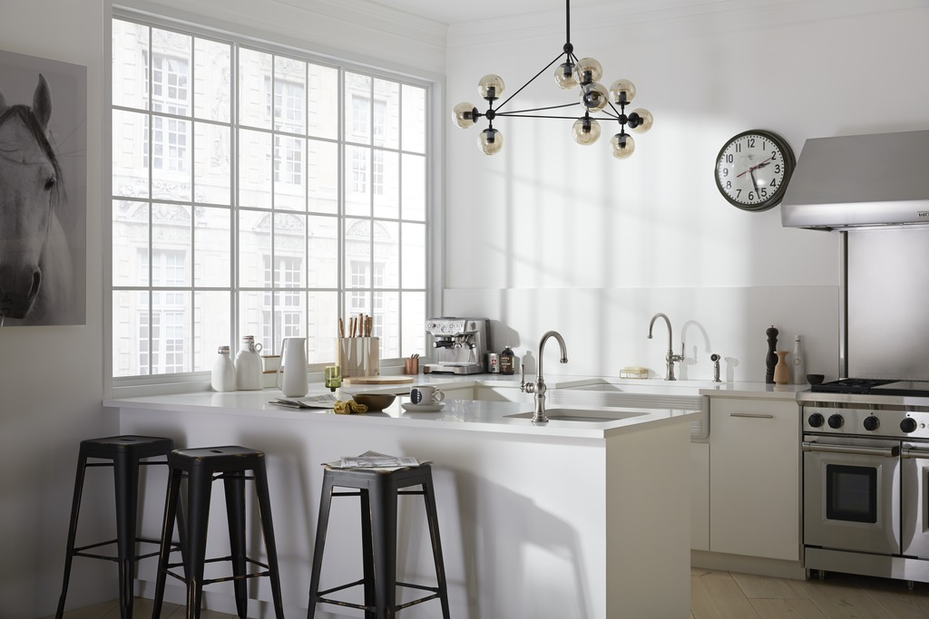 Artifacts faucet and sidespray   Whitehaven sink with Hayridge design   Artifacts single-hole faucet   Iron Tones bar sink   Generous warehouse-style windows welcome sunlight into a cook's kitchen that's equipped with two vintage-look sink and faucet pairs.