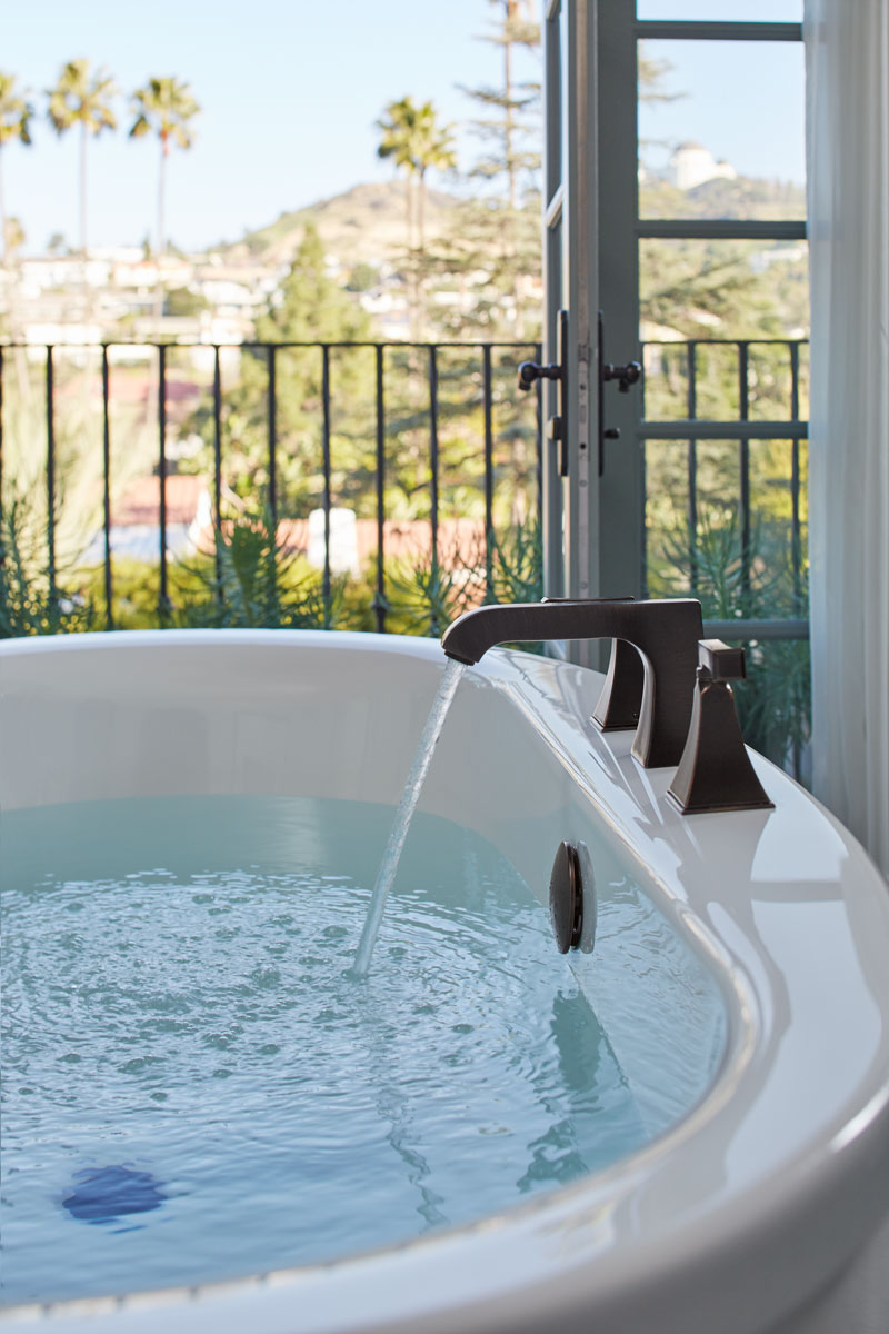 Sunstruck Freestanding Bath    Memoirs Bath Faucet    There's nothing quite like a deep soak with fresh air blowing through balcony doors and a stunning view of distant hills to make you never want to leave your bath.