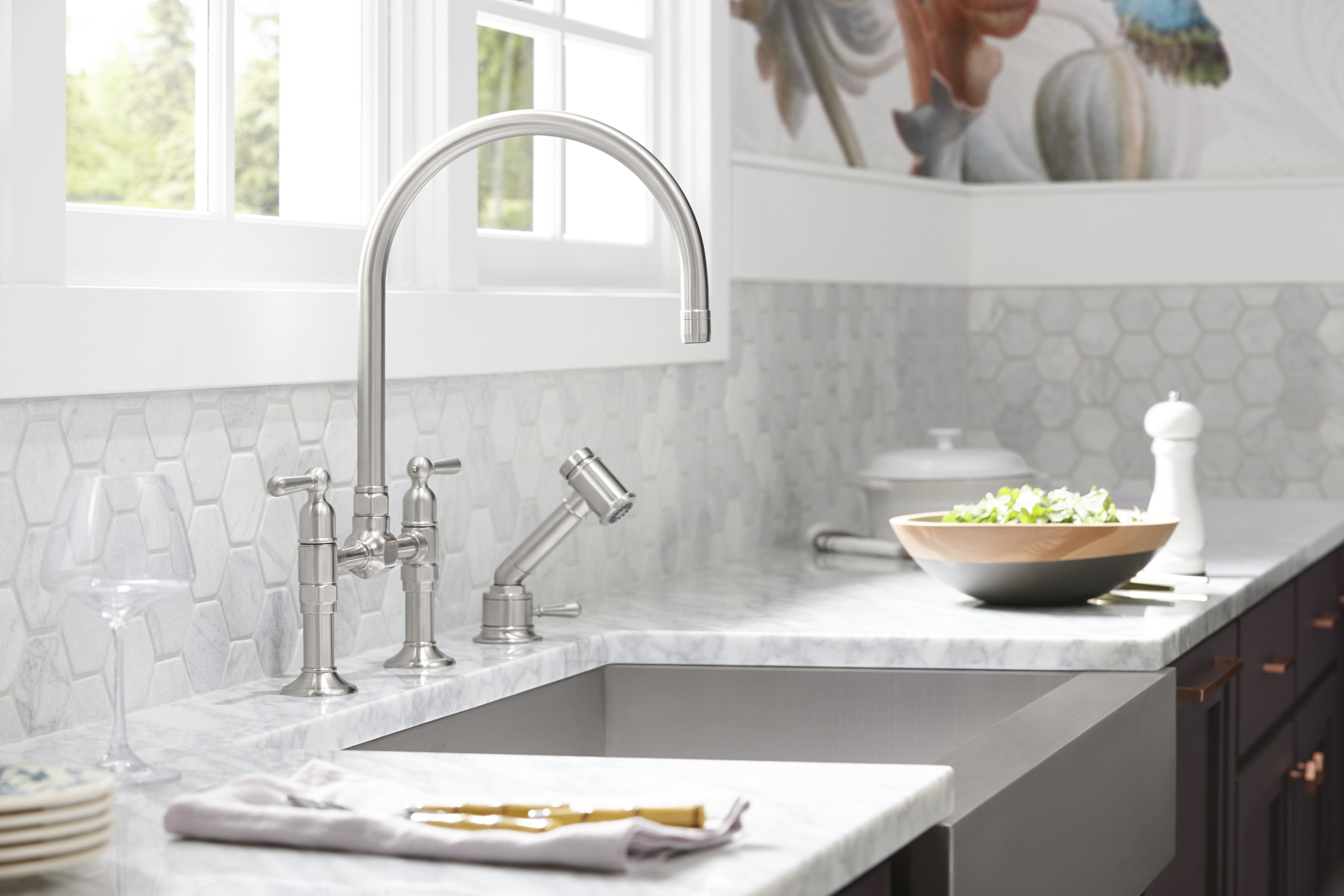 HiRise™ bridge kitchen faucet     HiRise sidespray     A deck-mount bridge faucet with a high, fully rotating gooseneck swing spout allows you to easily fit larger dishes underneath for cleaning.
