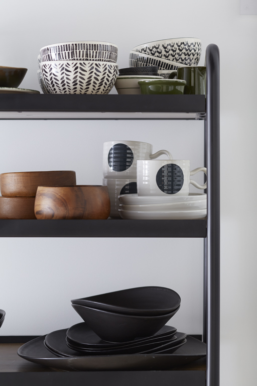 Accessories with subtle patterns and rich wood grain are perfect partners for an industrial-style kitchen with thoroughly modern functionality.