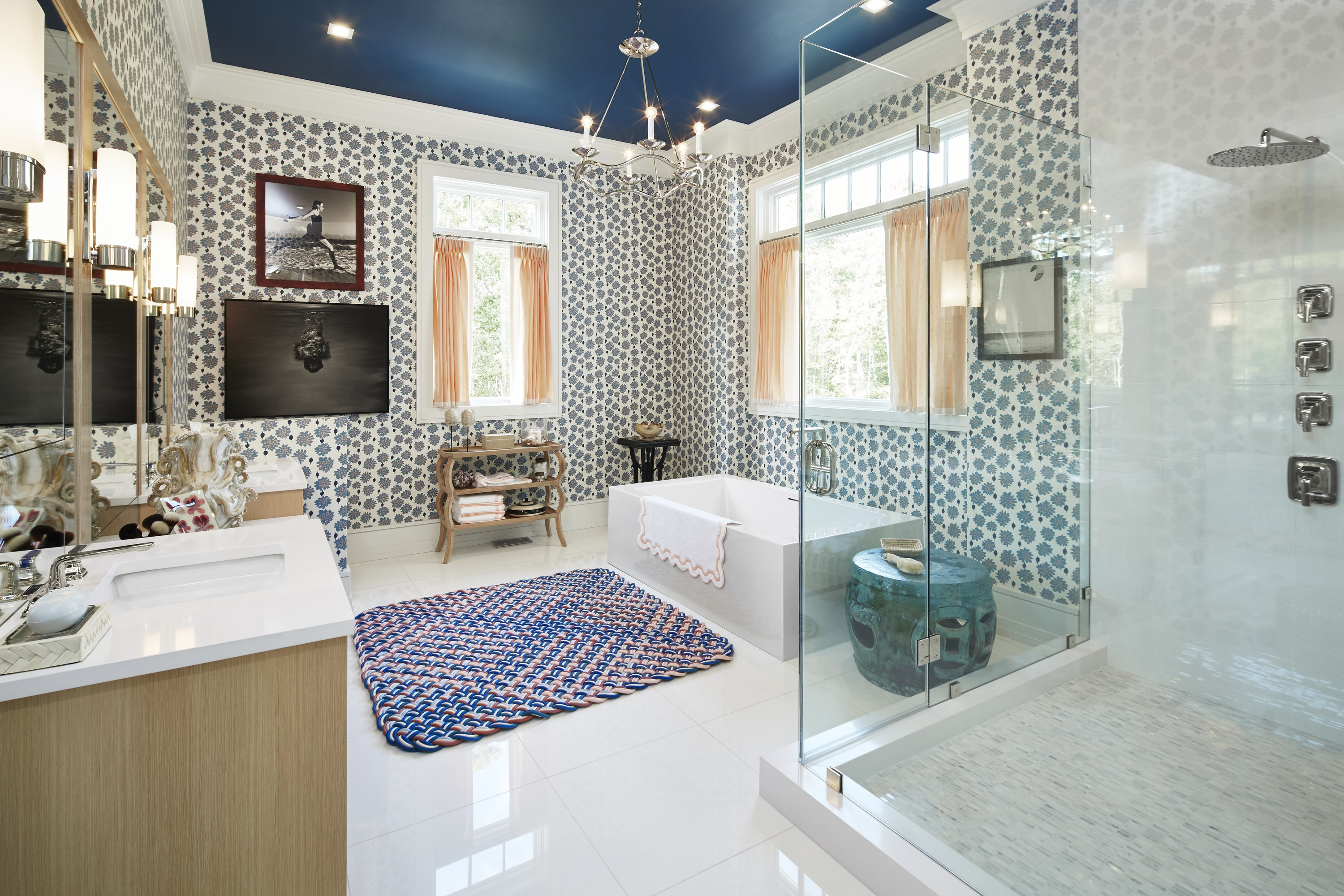 One Freestanding Bath     One Raindome Showerhead     Per Se Faucet     With a wonderful mix of abstract floral patterning and refined details, Tilton Fenwick's master bathroom conveys a sense of sophisticated whimsy.