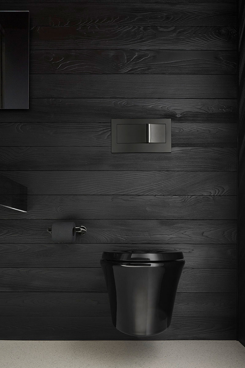 Veil Toilet    Veil Flush Actuator Plate    Composed Toilet Tissue Holder   The wall-hung toilet blends into the shadowy background to add even more drama to the space.