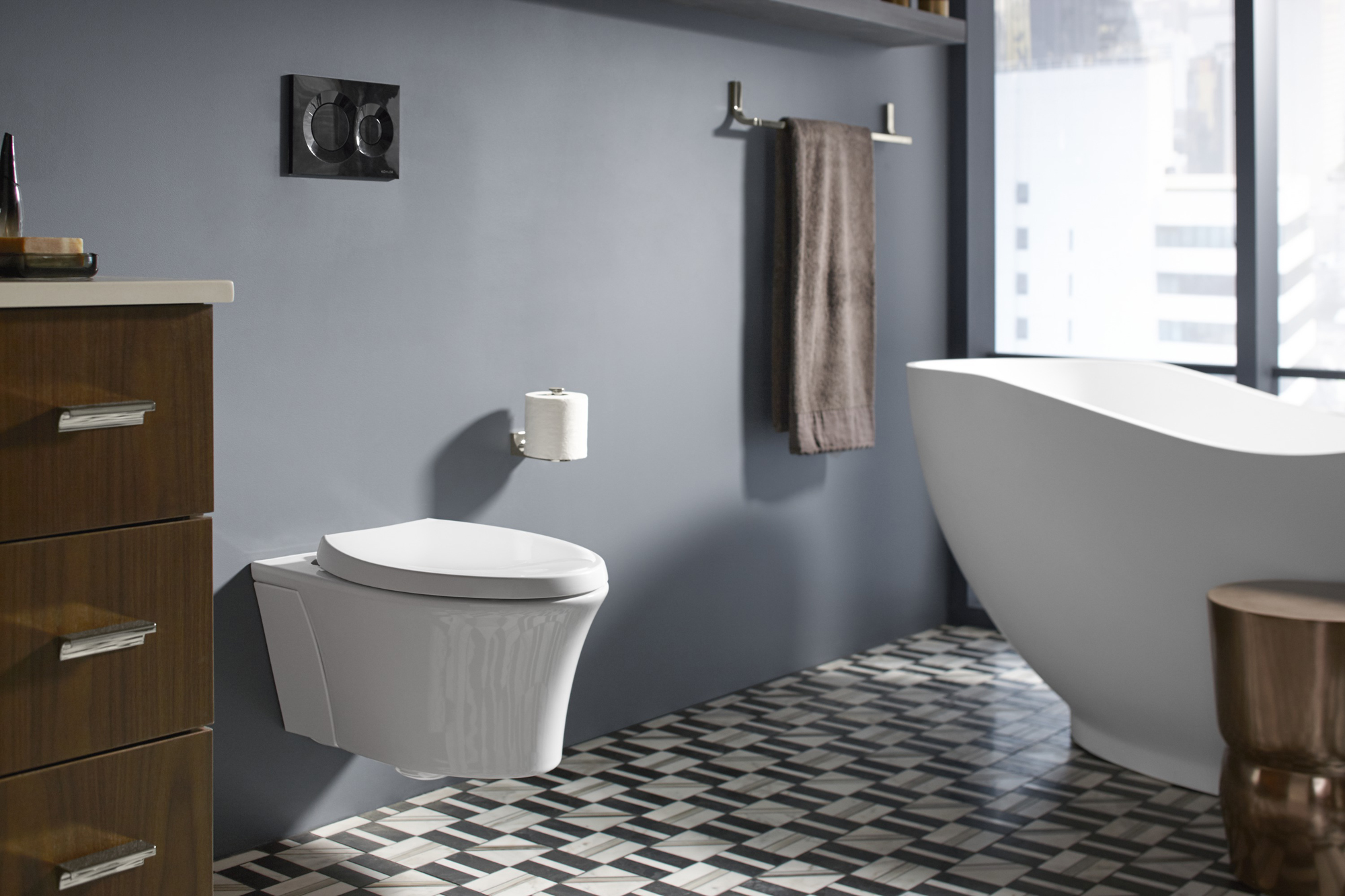 Loure® towel bar   Veil® toilet     A wall-hung toilet makes cleaning the floor easier and makes the space look more open.