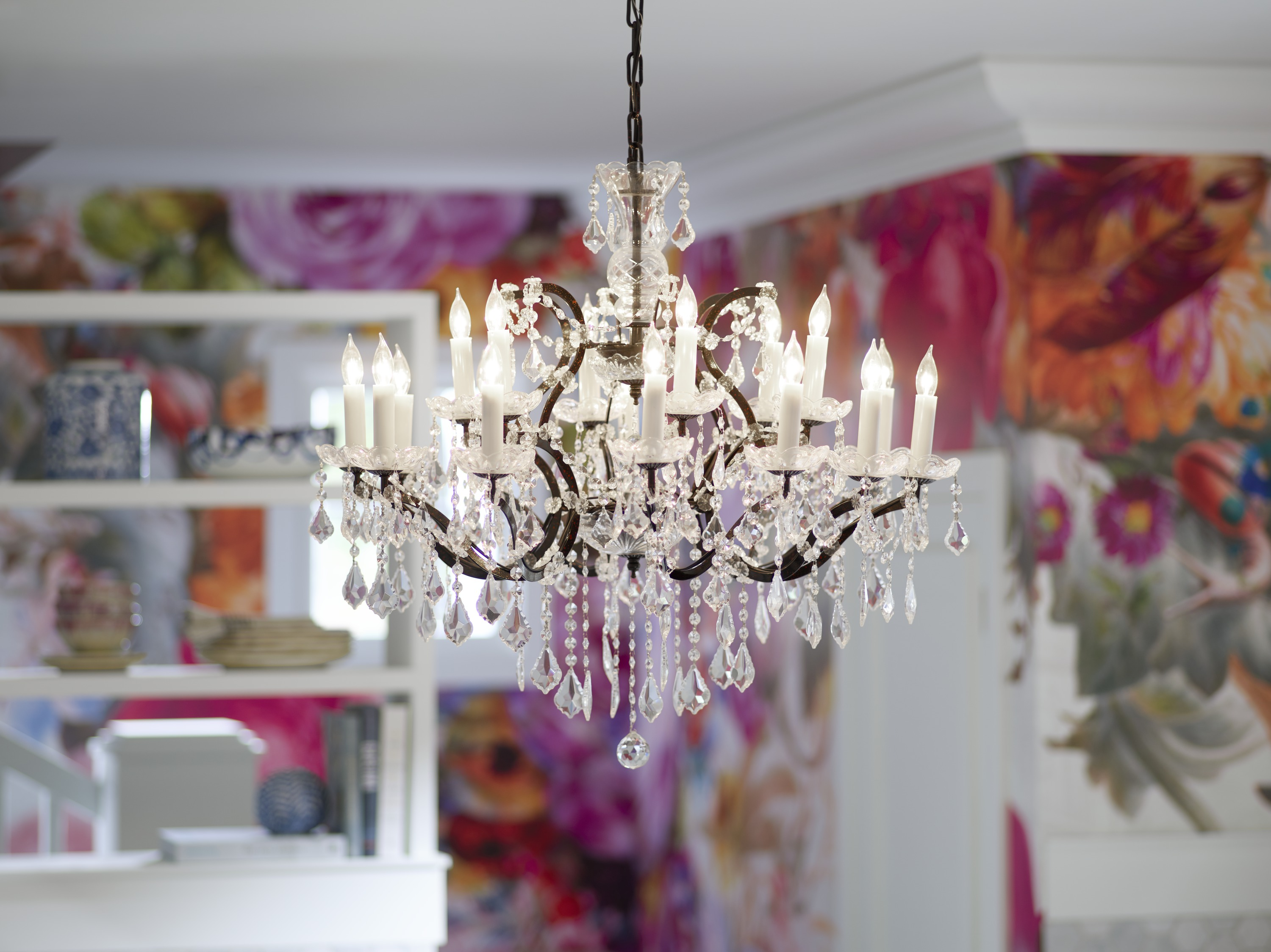 An intricate glass chandelier adds sophistication to a playful space.