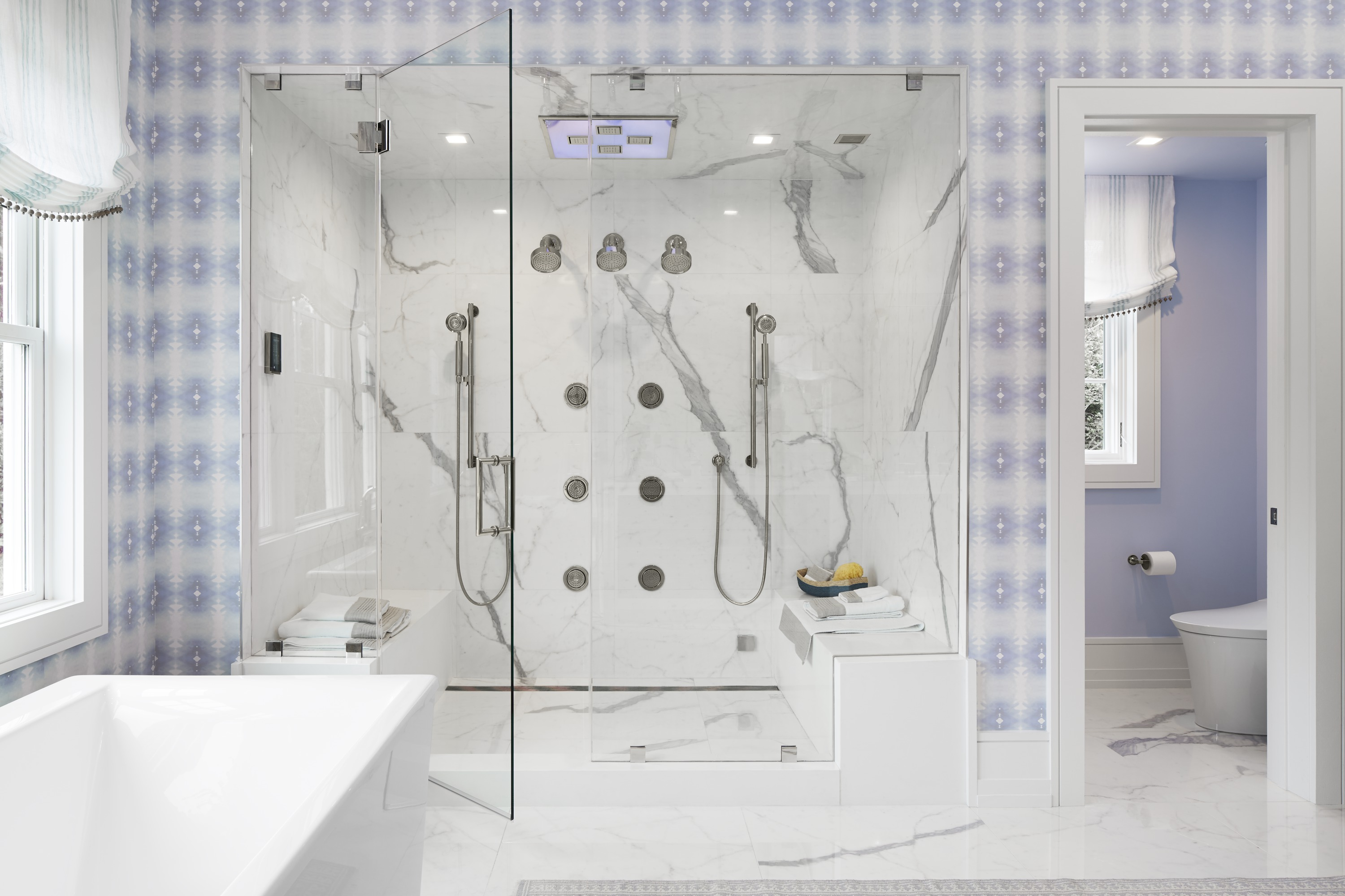 WaterTile Ambient Rain® Shower Panel     Purist Showerhead     WaterTile Body Spray     DTV+     Veil® Intelligent Toilet     Delivering highly personalized experiences, the two-person digital shower features a variety of shower sprays, including an overhead shower panel that blends soothing color therapy with a rain shower.