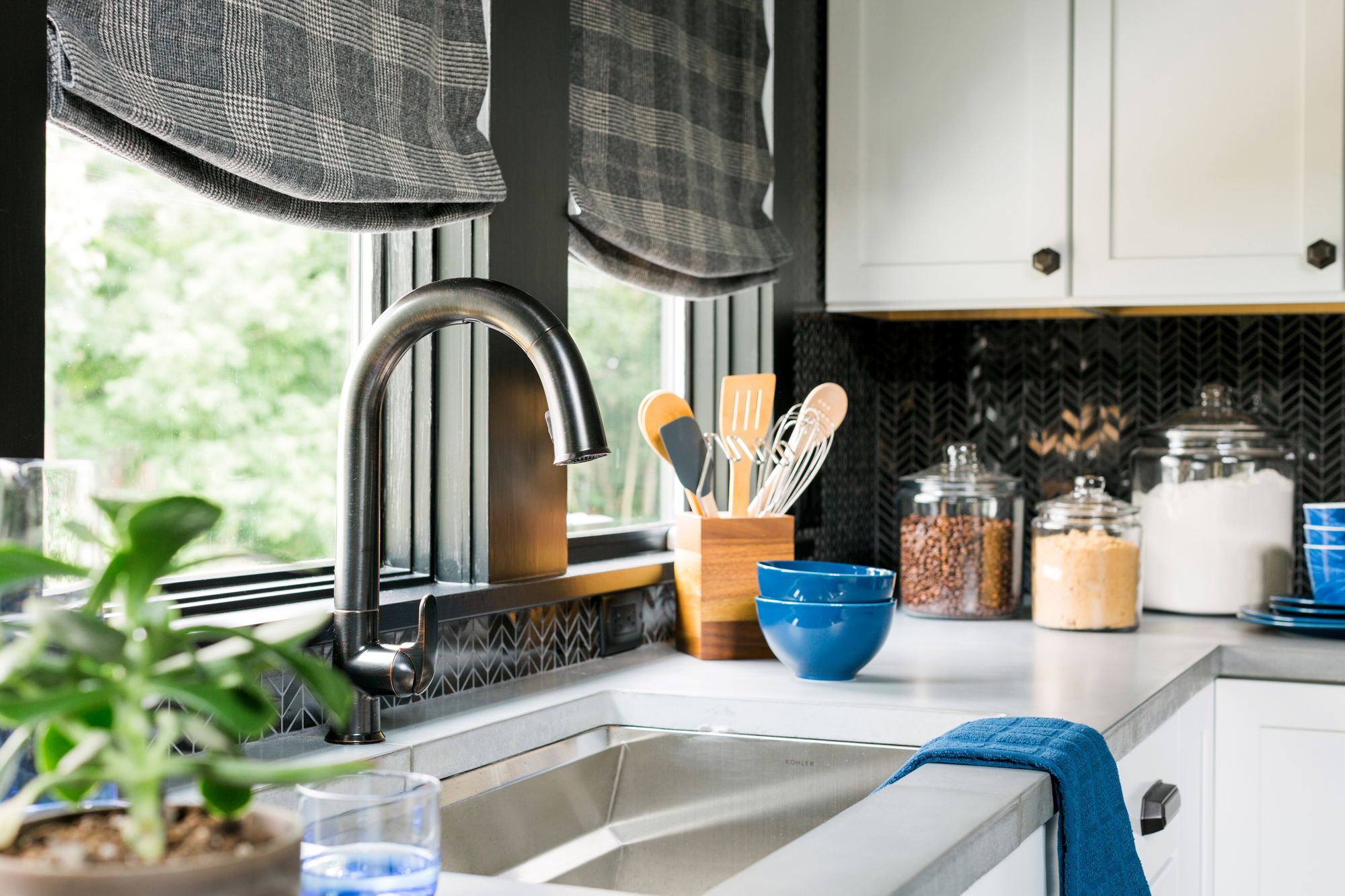 Sensate® faucet   Prolific® kitchen sink     A touchless faucet and stainless steel sink with custom, stackable accessories give this small kitchen an innovative edge and extra efficiency when it comes to tackling meal prep and cleanup.