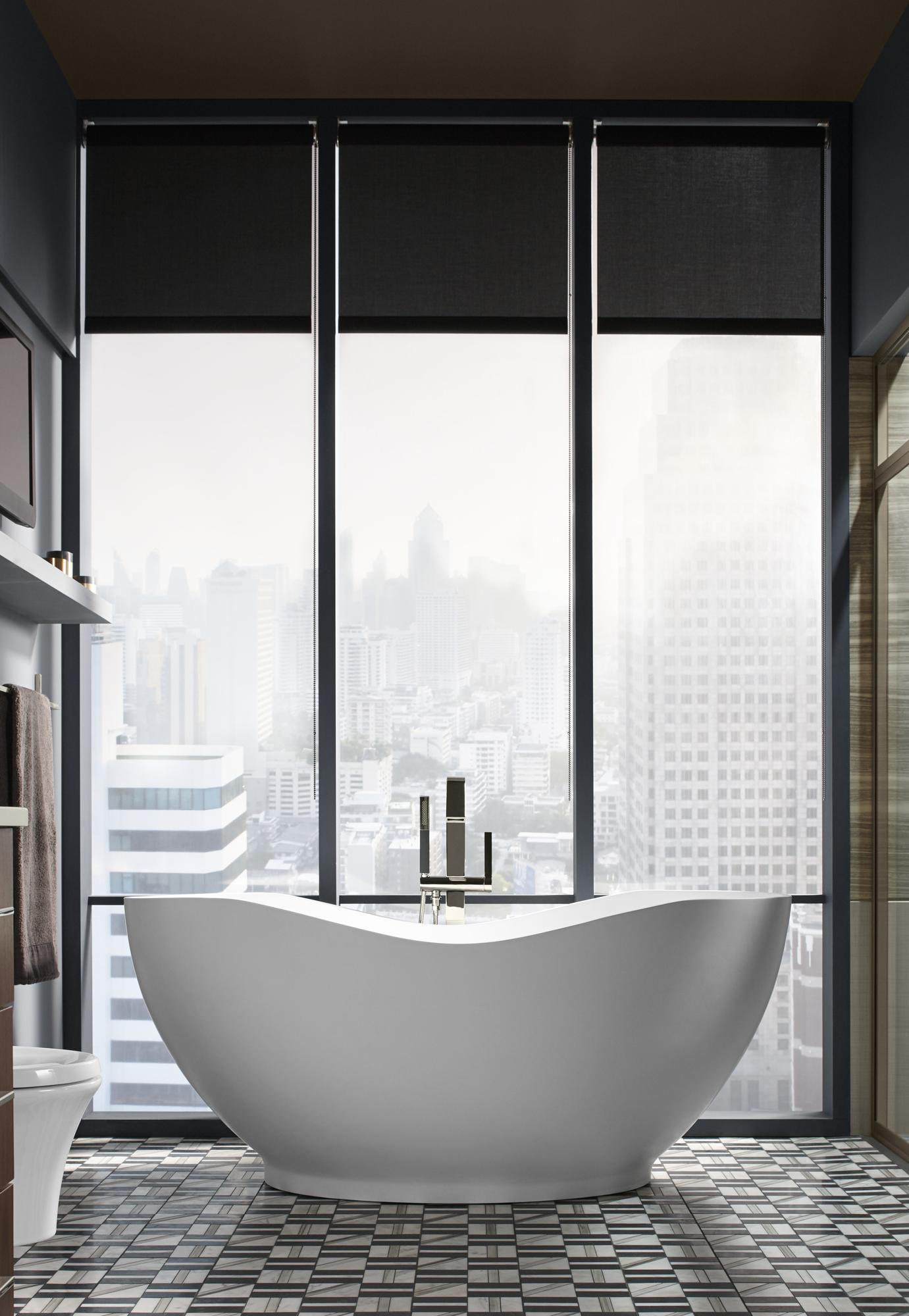 Abrazo® bath   Loure® bath filler     This bath's teacup design introduces clean, organic curves into a modern space.