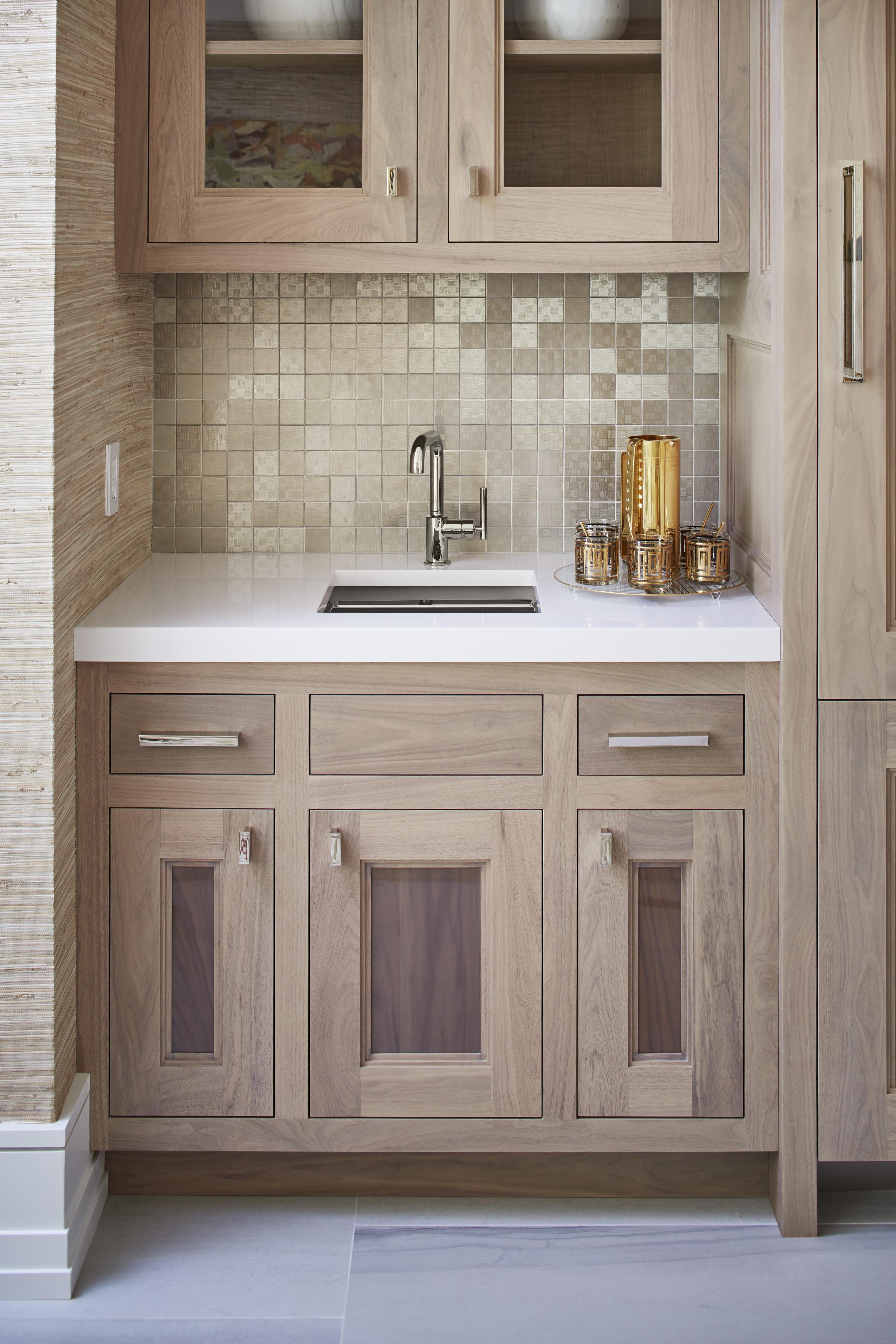 Purist Faucet     Poise Bar Sink     A design gem hidden in the rec room, the wet bar brings together custom wood cabinetry with a shimmering metallic backsplash.