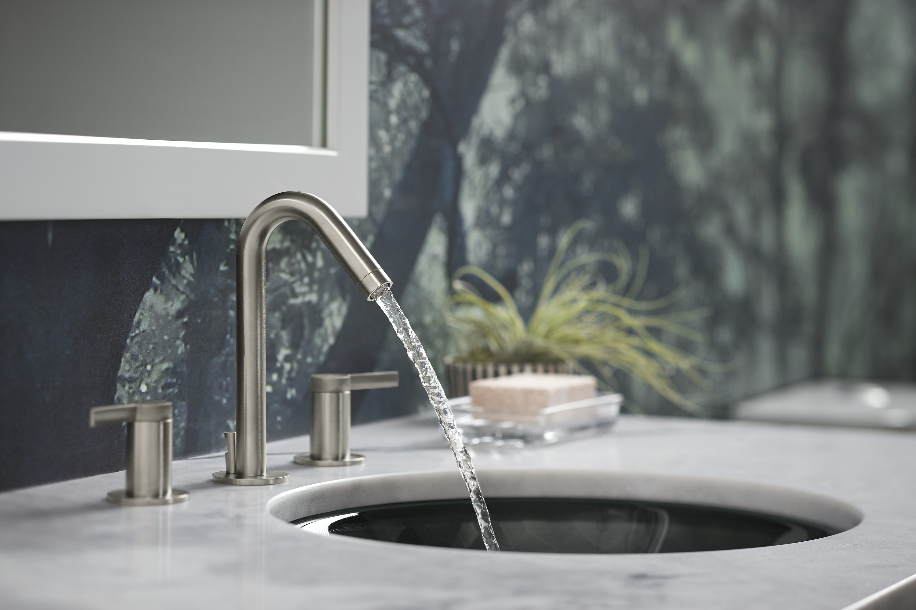 Stillness® faucet     With a slim profile and tubular design, this faucet mirrors the round shape of the sink.