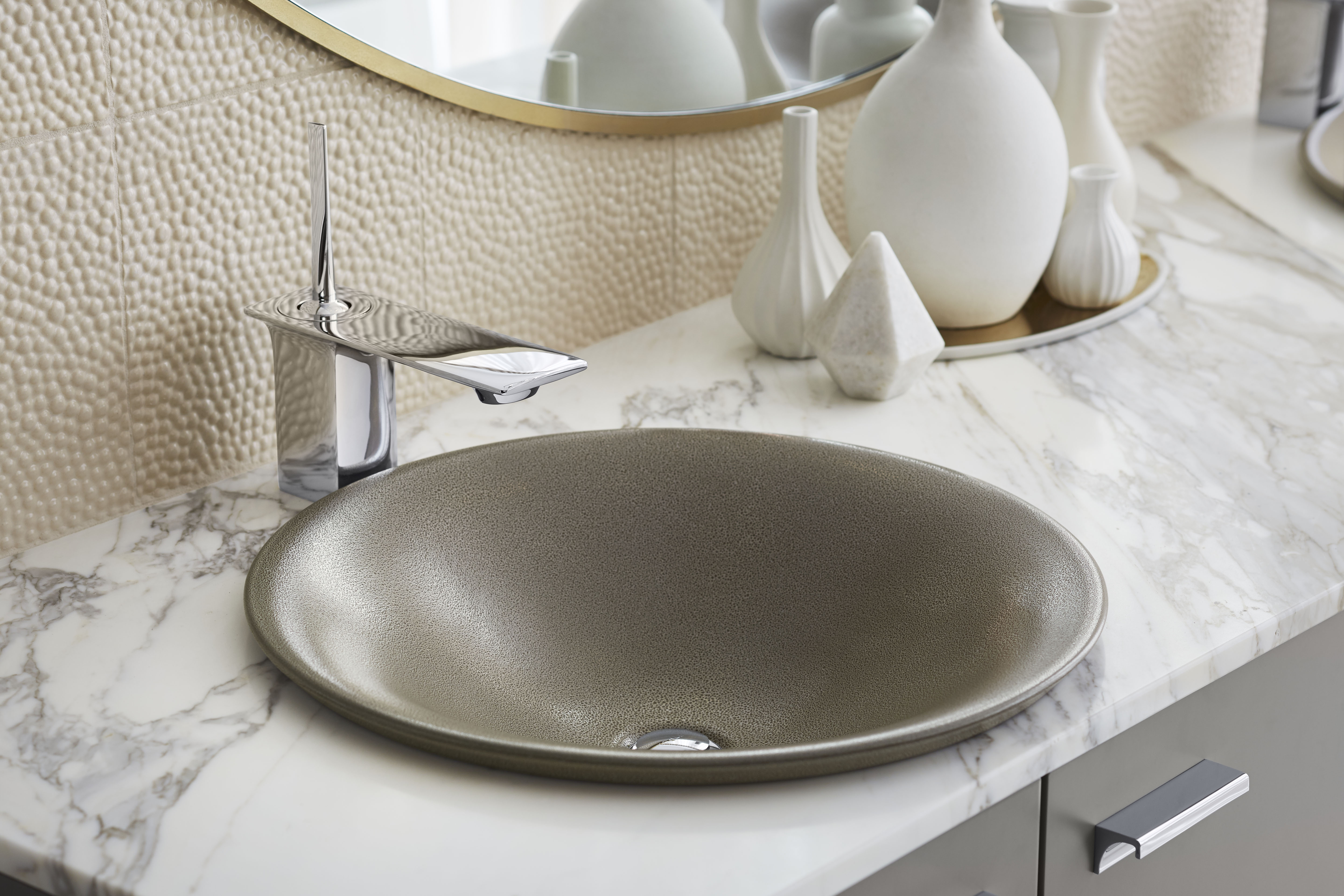 Shagreen Carillon sink     Stance Faucet     Blend warm and cool tones when mixing metals. The subtle gold finish on this mirror balances with the chrome faucet.