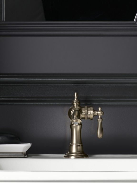 Artifacts faucet   A vintage-inspired faucet glows like a classic sculpture against a black wall.