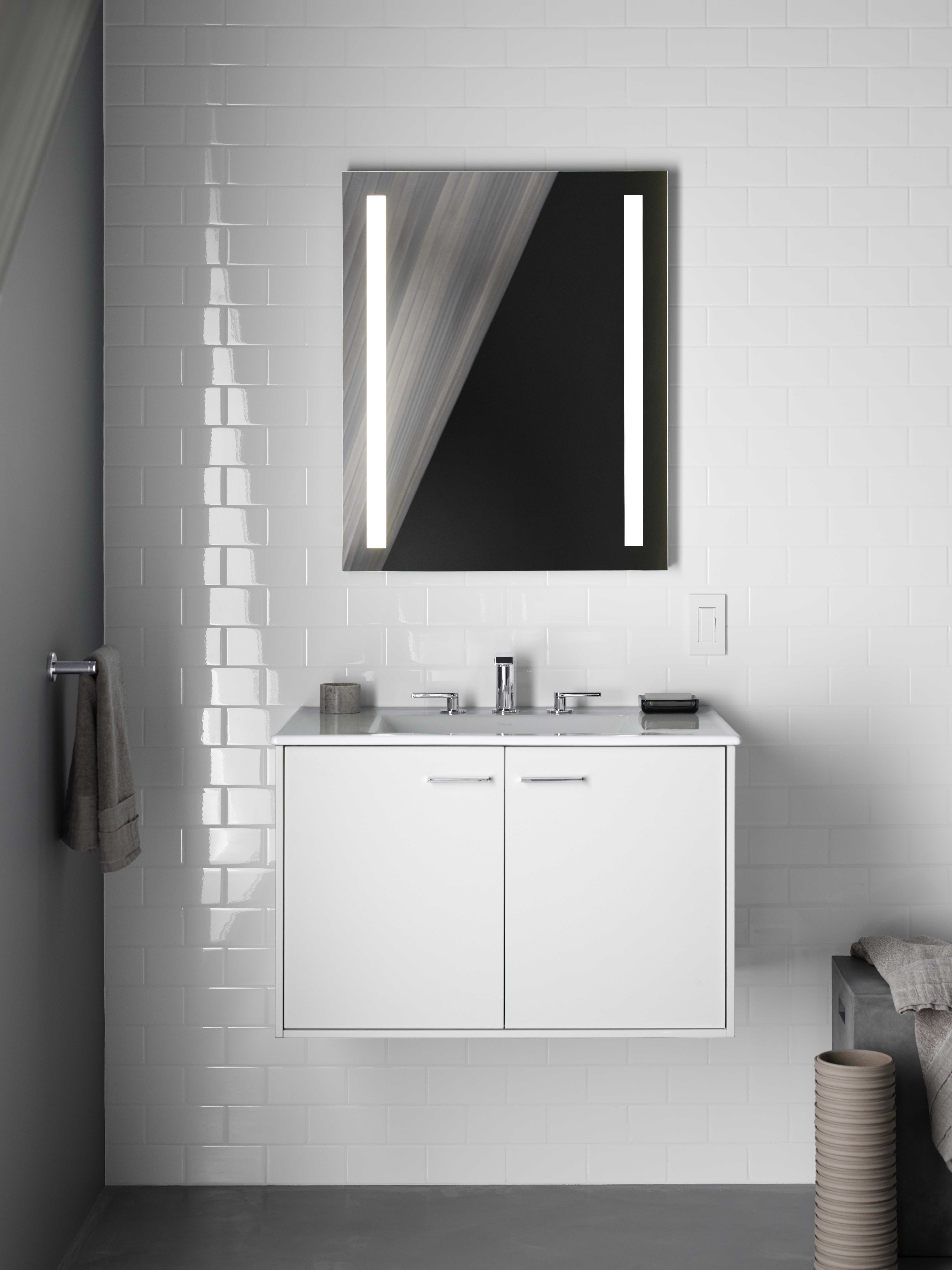 Jute® Vanity     Verdera lighted medicine cabinet     Composed Faucet     Mixing a matte-finished vanity with high-gloss walls bring layered visual interest to the space.