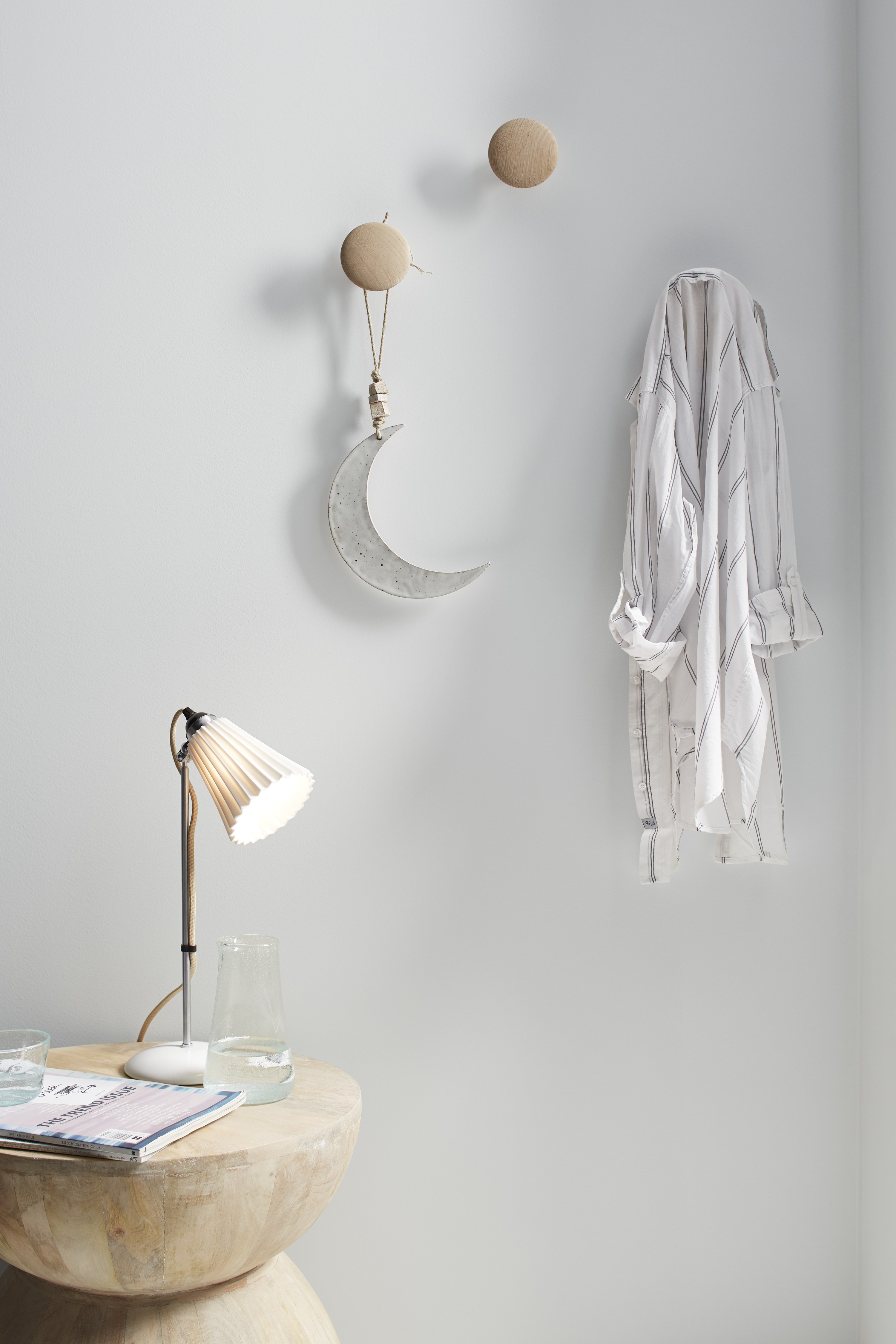 Simply designed organic accent pieces reinforce the room's Scandinavian style.