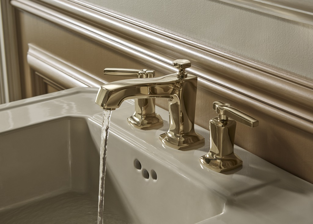 Margaux faucet   Kathryn pedestal sink   A gold-finish faucet adds sparkle to a subdued, neutral-hued sink.