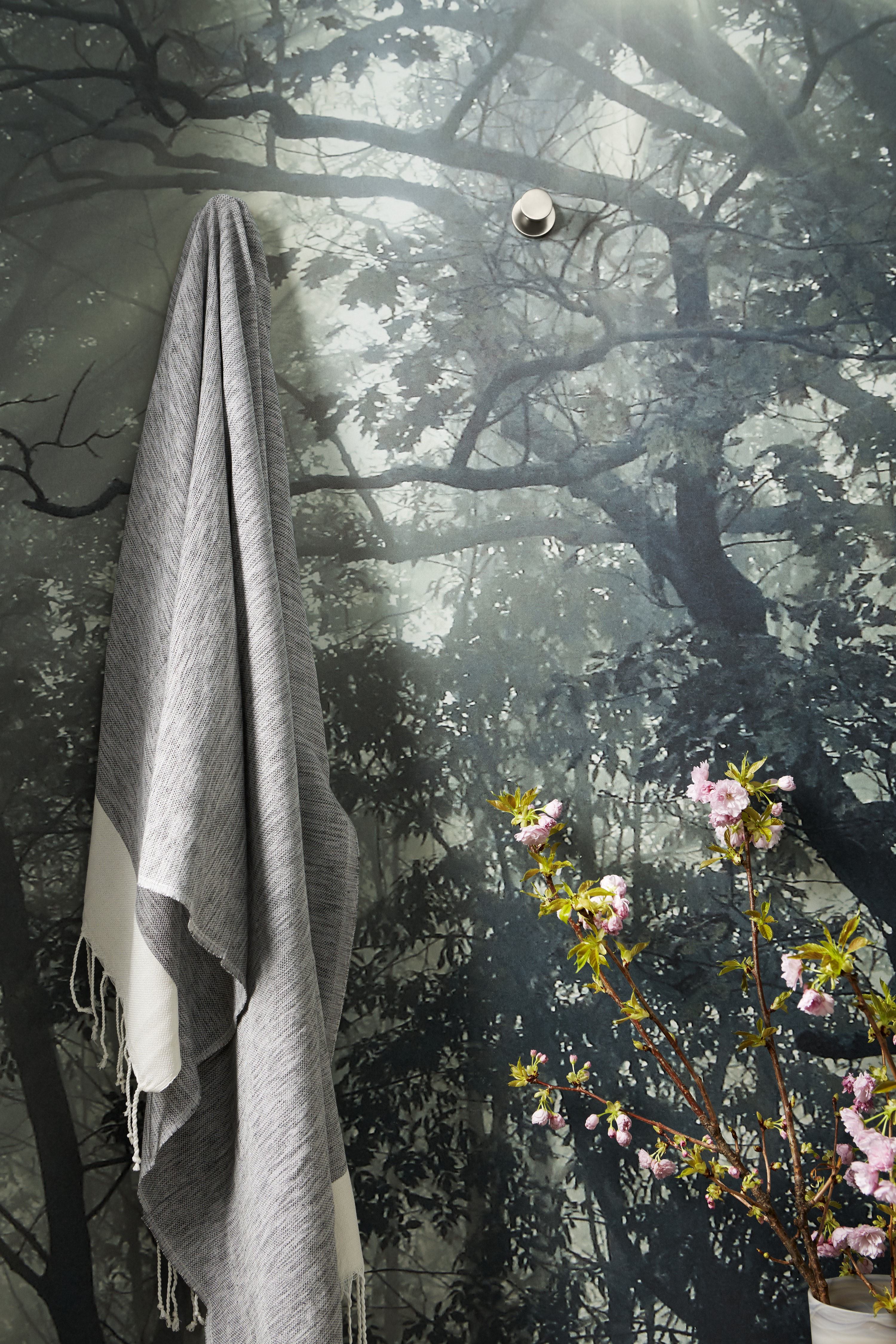 Stillness® robe hook     Custom photorealistic wallpaper draws on nature-inspired elements of Scandinavian design and brings the outdoors in.