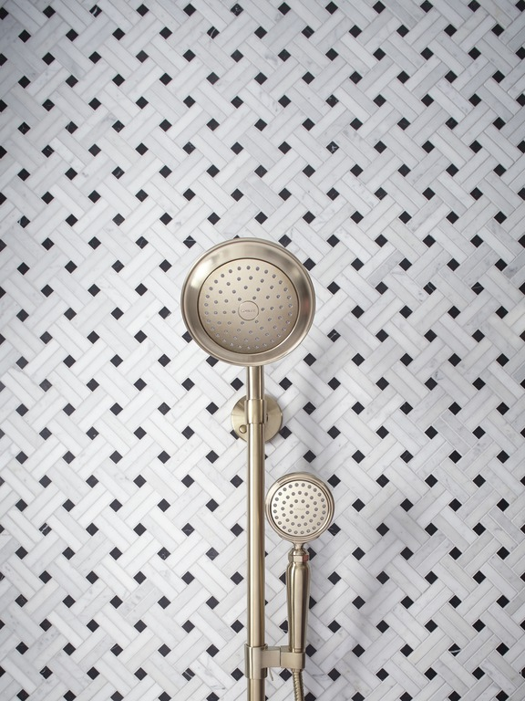 Ann Sacks Carrara Mosaic tile   Artifacts handshower  and  showerhead   HydroRail shower column   There's nothing like a handshower for convenience. Especially in a brushed bronze finish that shines like jewelry.